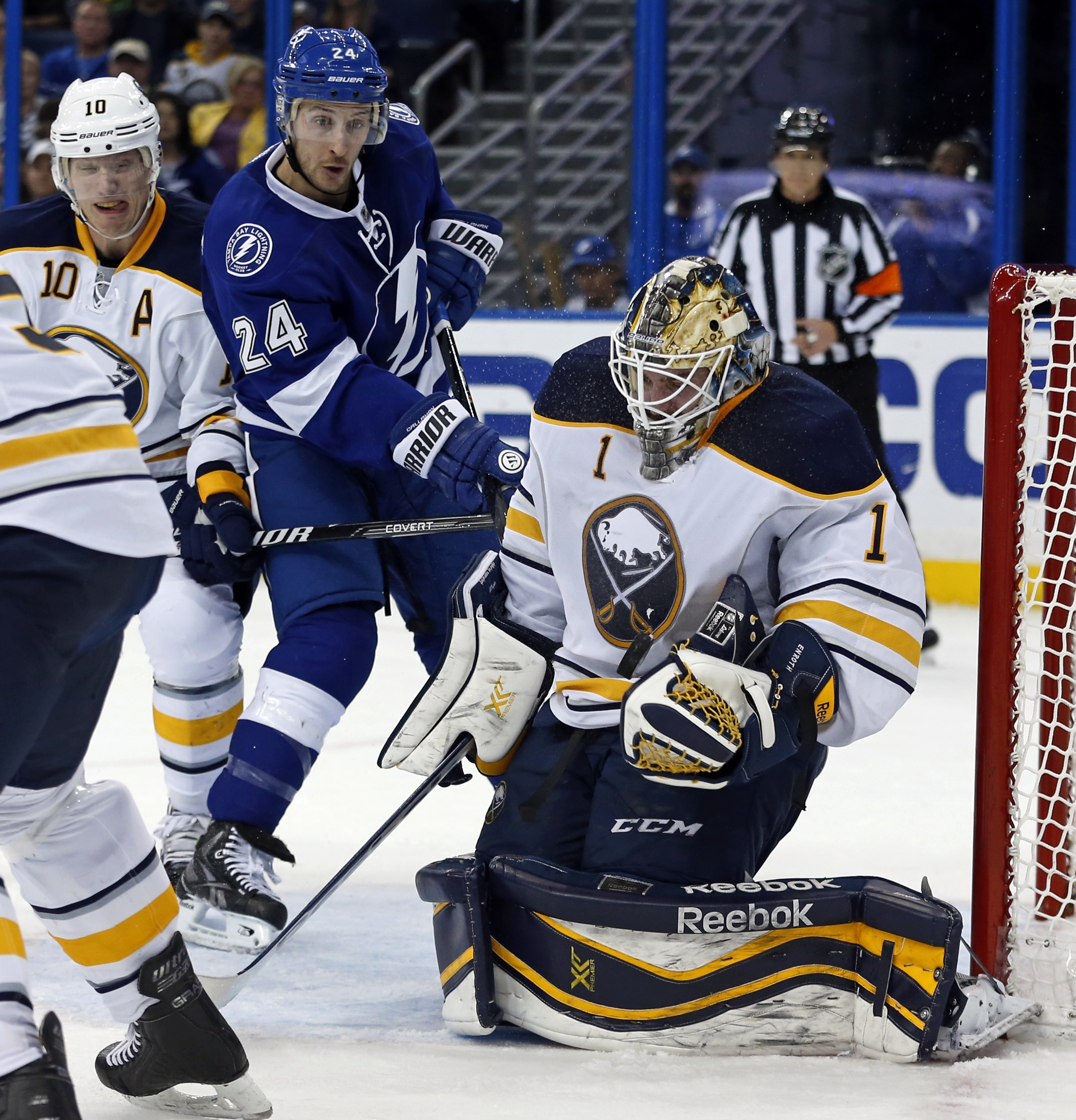 With the Lightning's Ryan Callahan at the doorstep, Sabres goalie Jhonas Enroth makes one of his 43 saves.