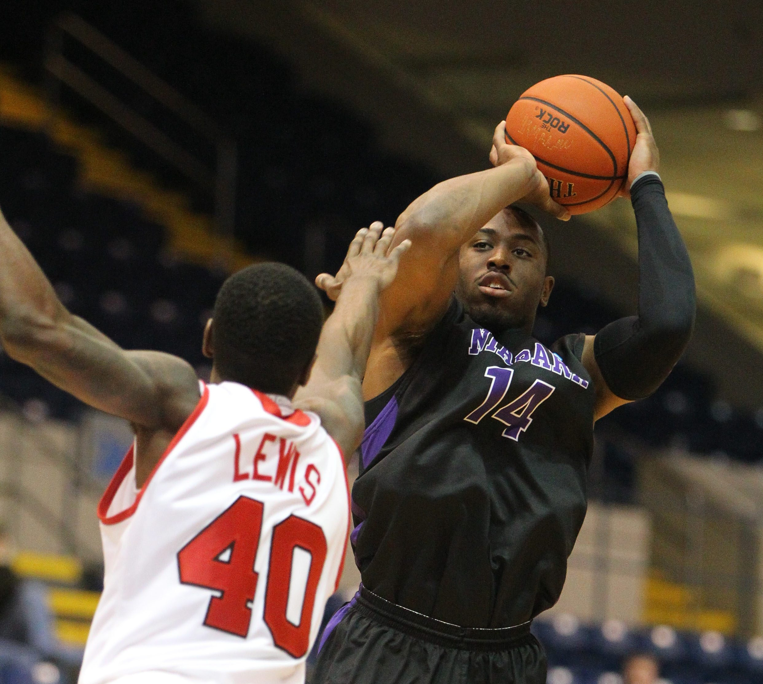 Niagara's Antoine Mason lifts a shot over Marist's Chavaughn Lewis in the first half . Mason scored 38 points as the Purple Eagles surprised Marist, 78-76, in the MAAC Tournament.