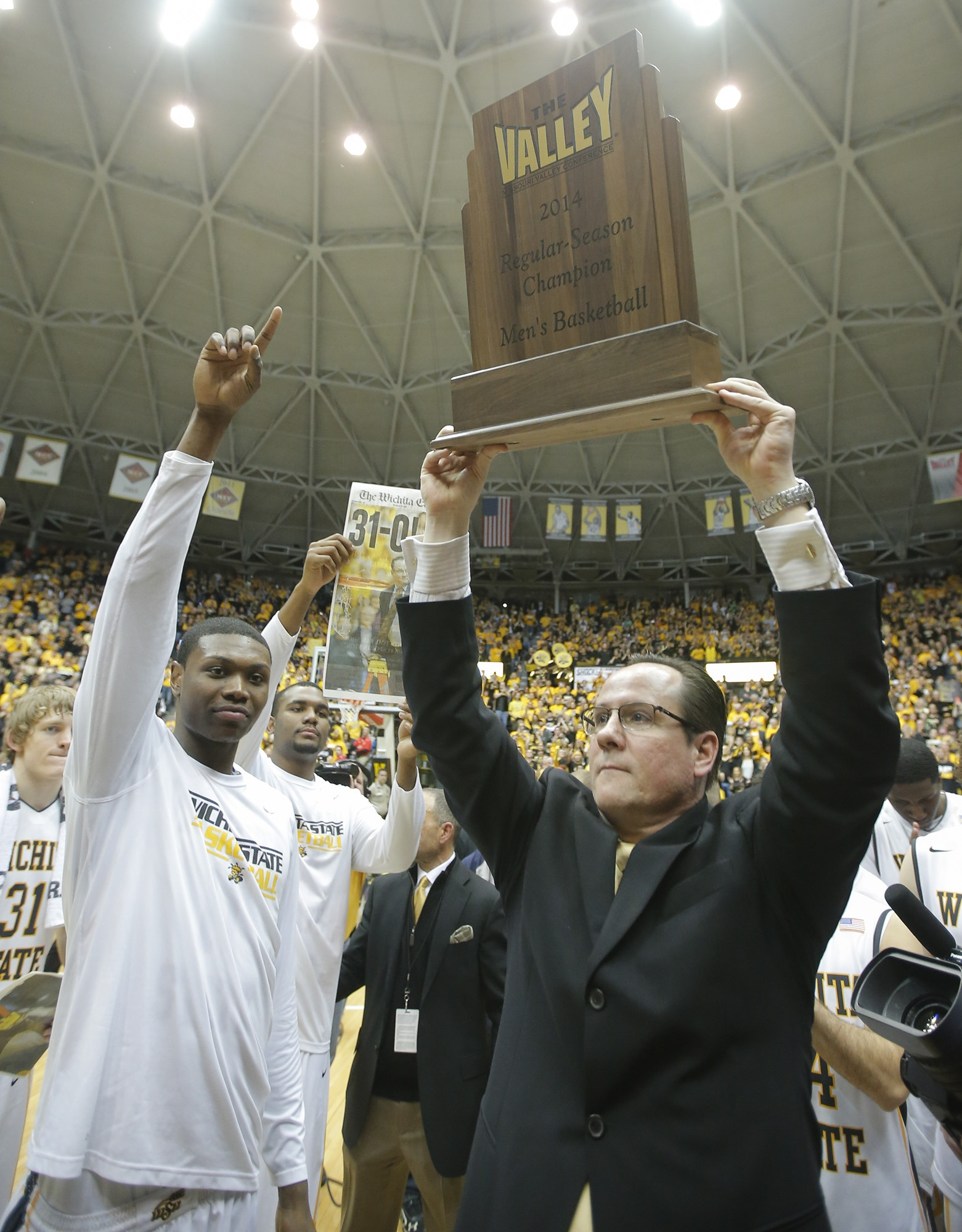Coach Gregg Marshall and Wichita State took home a big trophy after winning the Missouri Valley Conference regular season title.