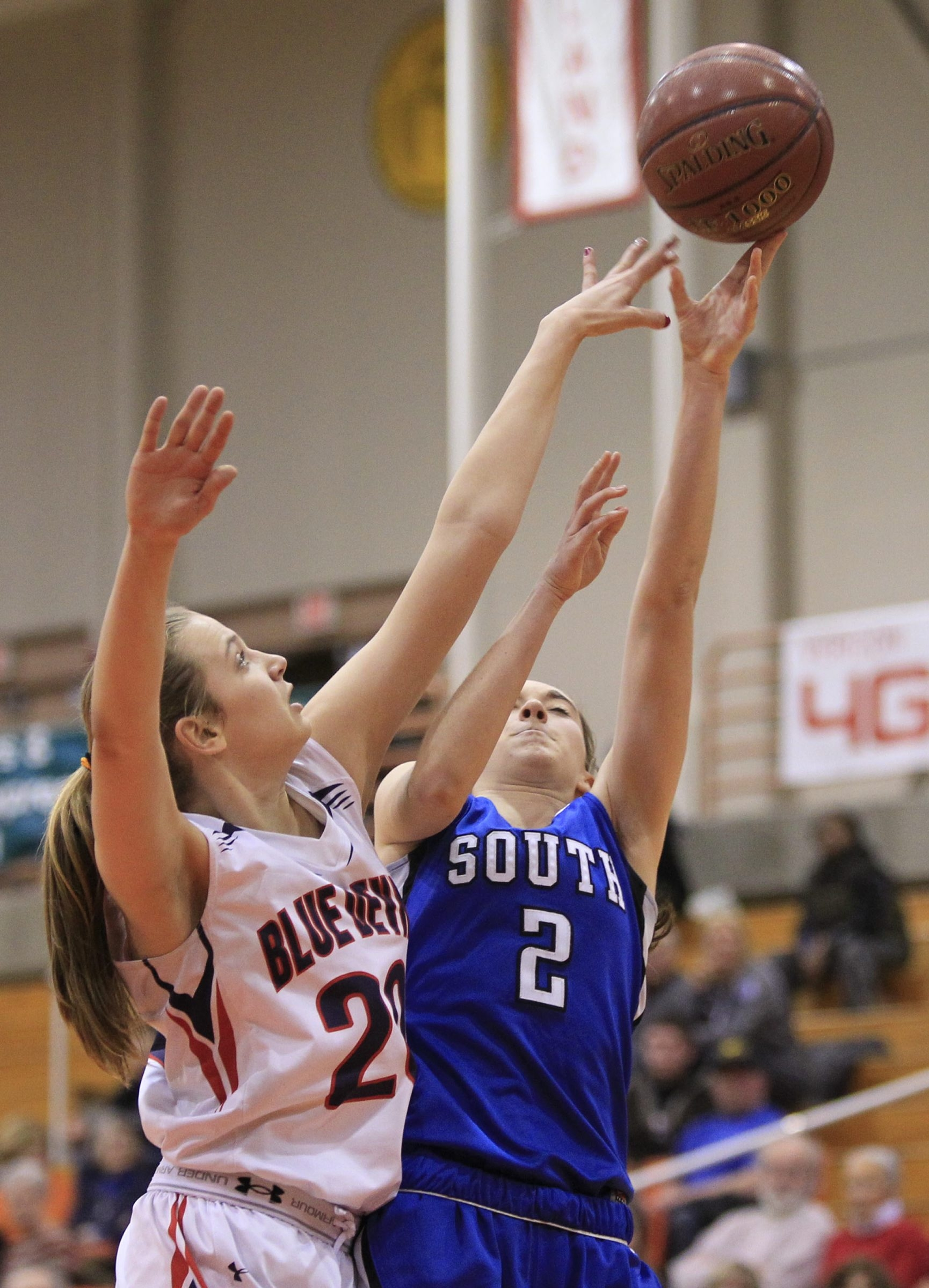 In girls sectional basketball action: East Aurora's Emma Brinker (20) tips a shot by Erin Egan (2) of Williamsville South (left); Chrisanna Green (10) of Jamestown and Ericka Taplin of Williamsville North (32) battle (top right). and Alanna Herne (14) shoots for Tonawanda (bottom right).  .
