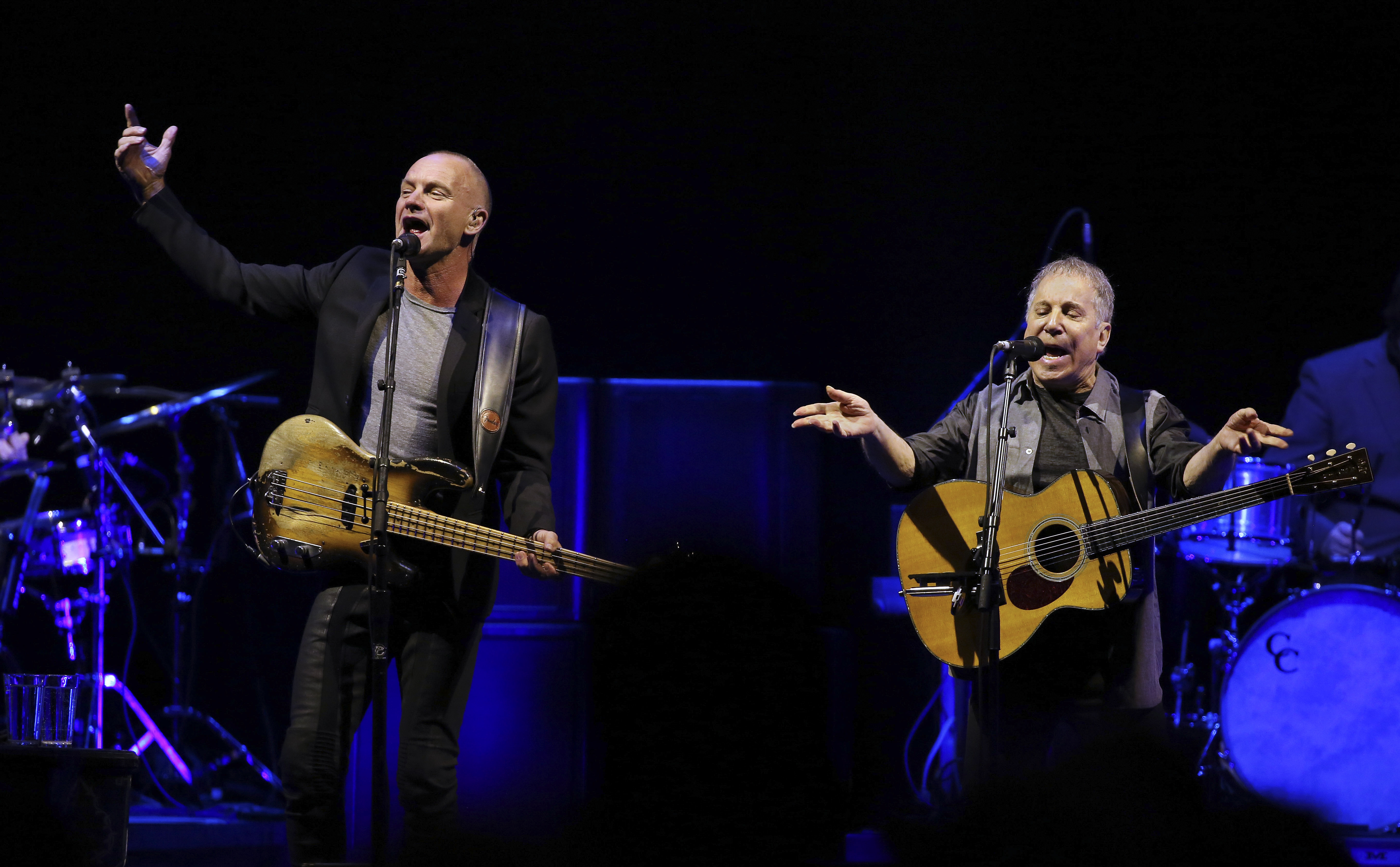 Sting and Paul Simon perform on the first evening of a two-night engagement at Madison Square Garden in New York on Tuesday.
