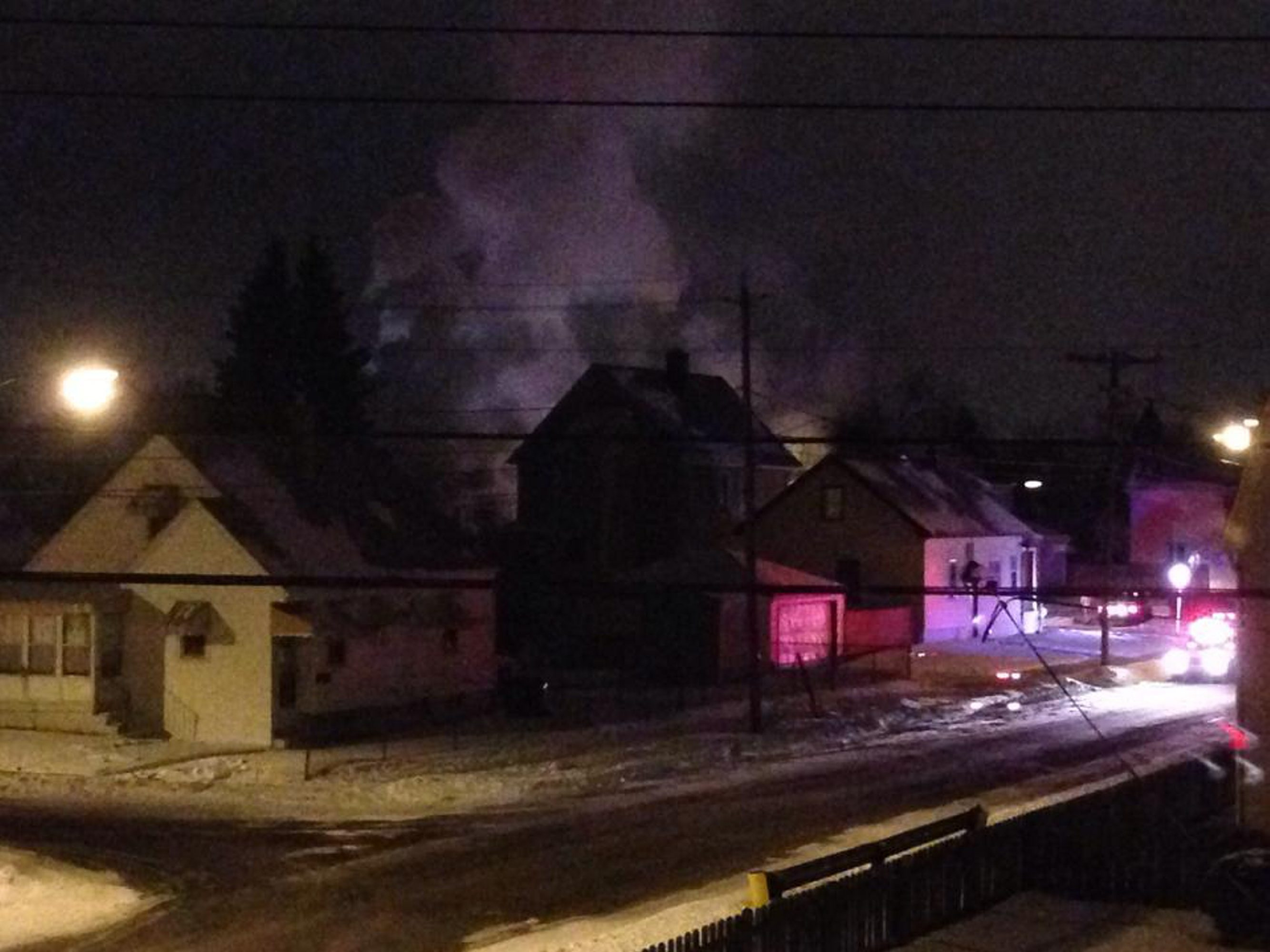 Smoke billows from a home on Sirret Street in South Buffalo Tuesday night. A man and his dog died in the blaze.