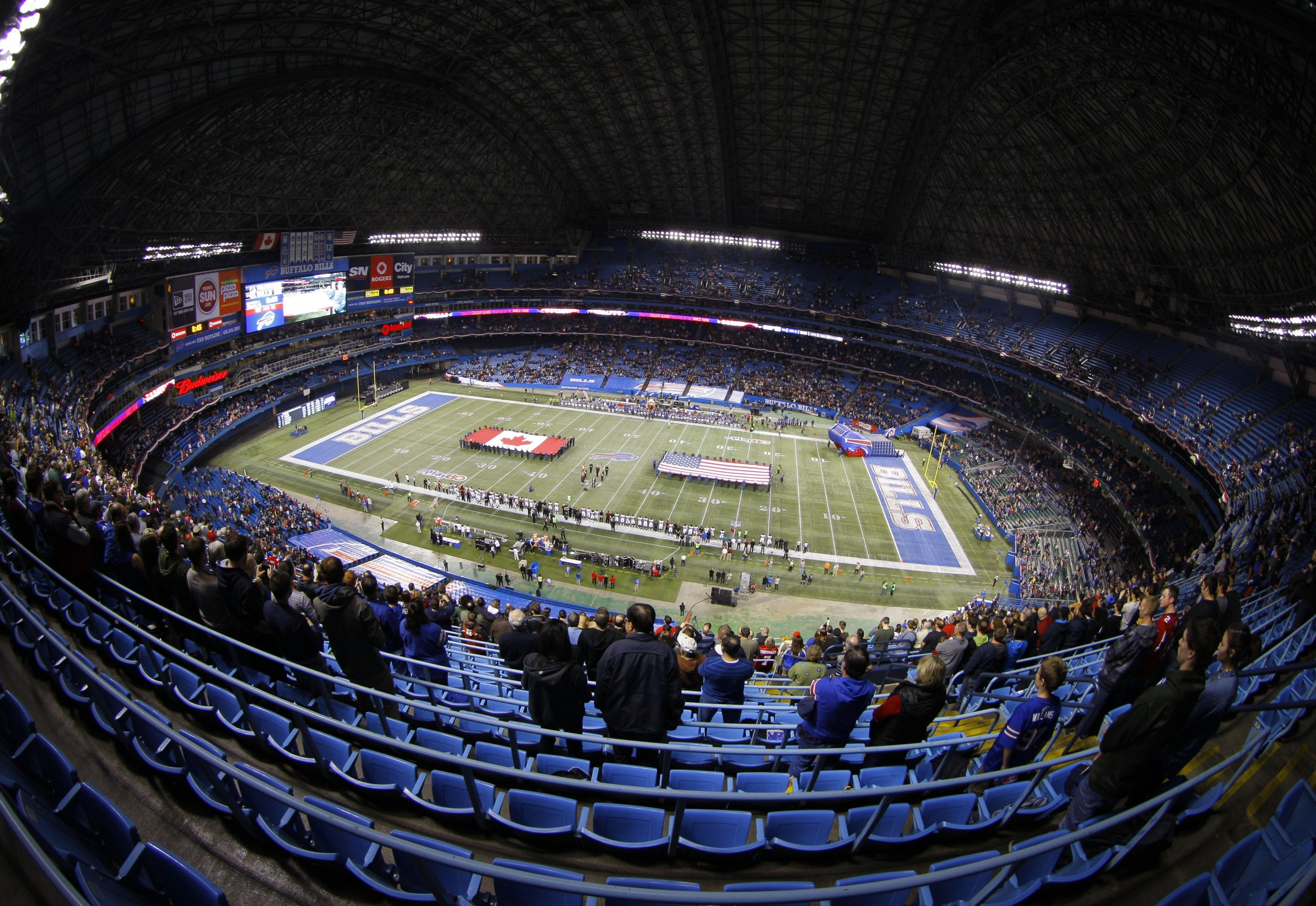 The Buffalo Bills take the field at the Rogers Centre in Toronto on Dec. 1, 2013.  The game drew an announced crowd of 38,969, at least 12,000 short of a sellout.