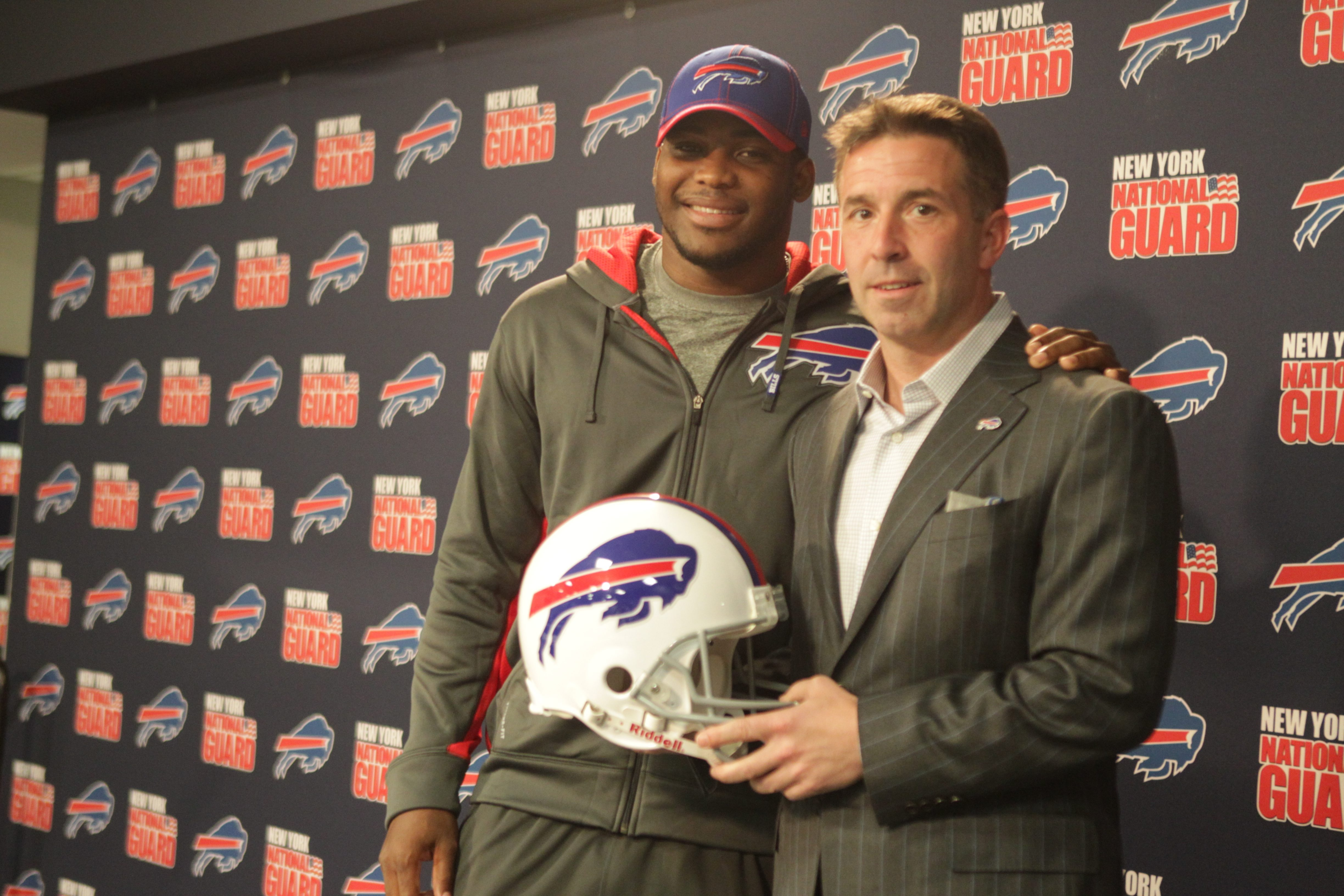Buffalo Bills President and CEO Russ Brandon with Safety Aaron Williams after announcing contract extension for Williams at Ralph Wilson Fieldhouse today.