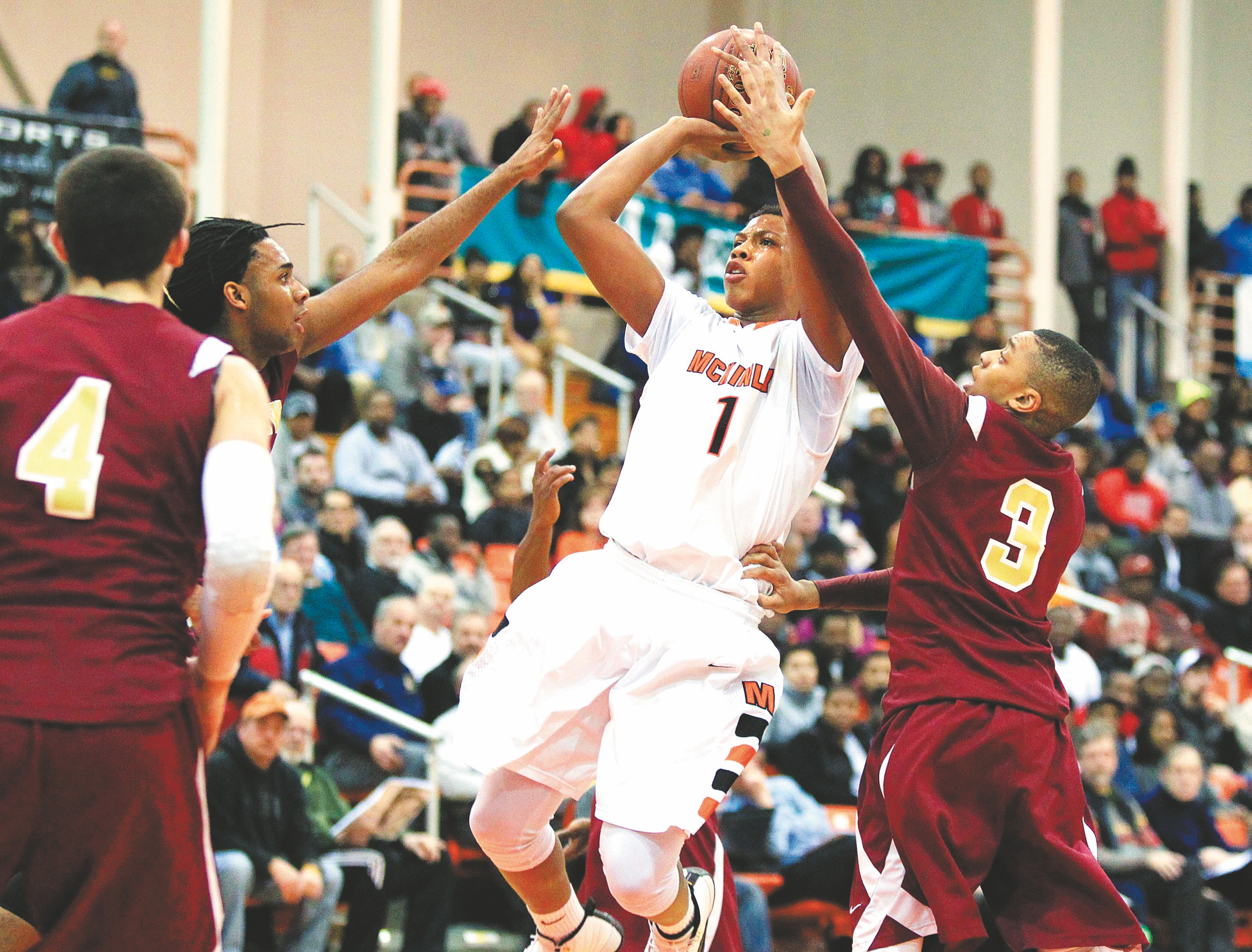 McKinley's Devon Morris (1) shoots between three Cheektowaga players in Tuesday's game at Buffalo State.