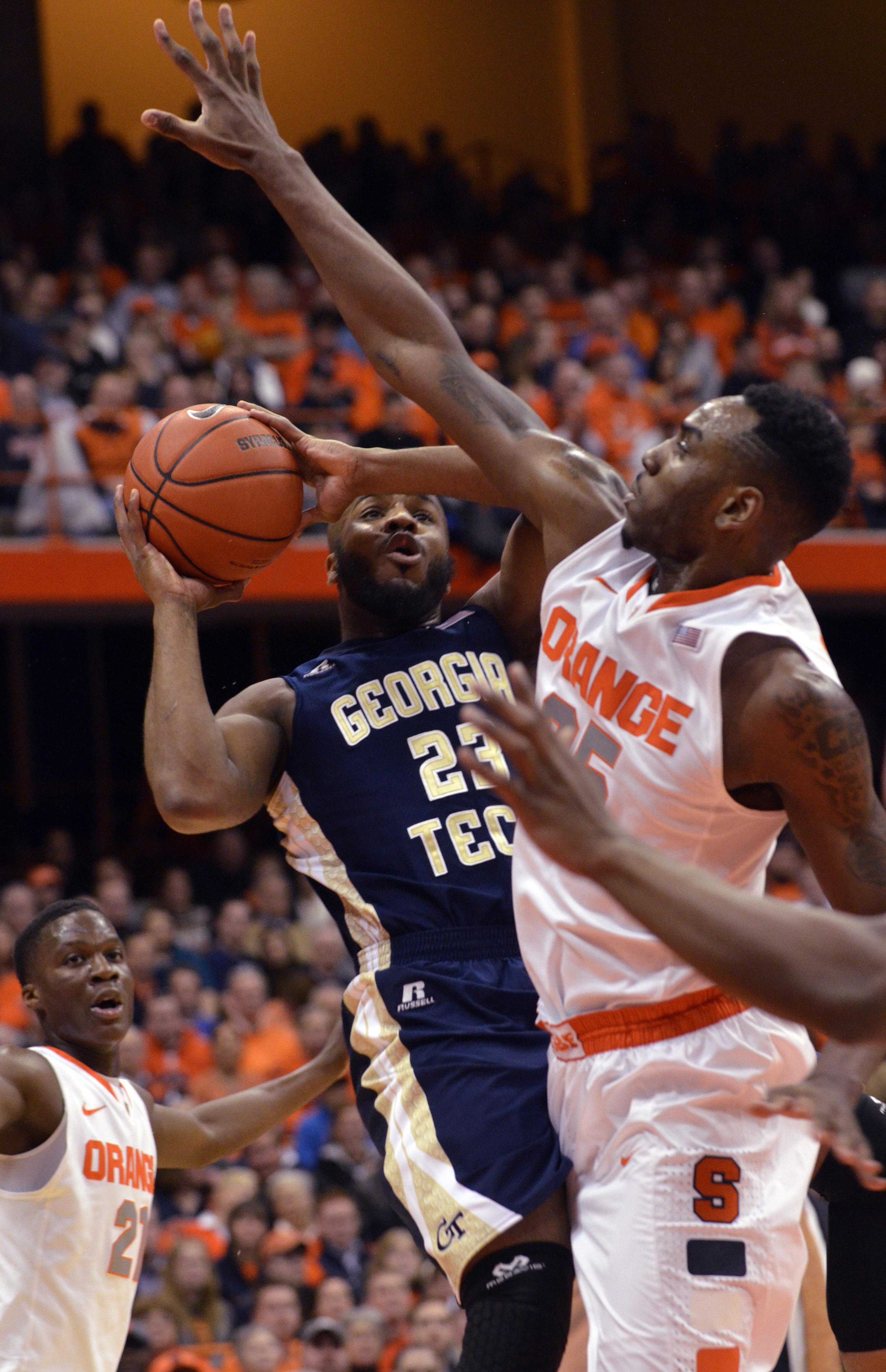 Georgia Tech's Trae Golden drives against Syracuse's Rakeem Christmas in the first half.