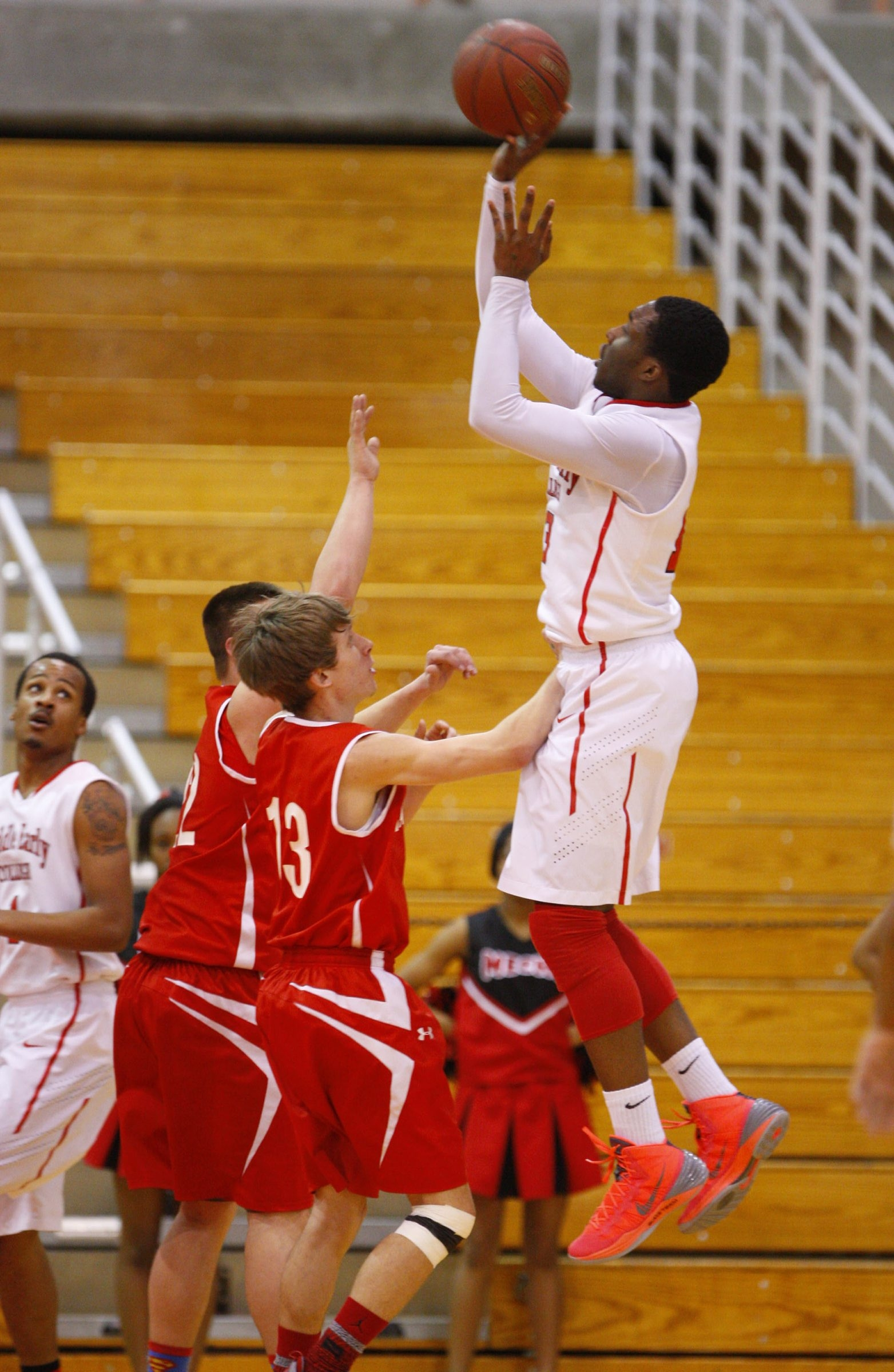 Middle Early College's Brian Brown (13) shoots a jumper over Randolph players during the second half of the Kats' victory.