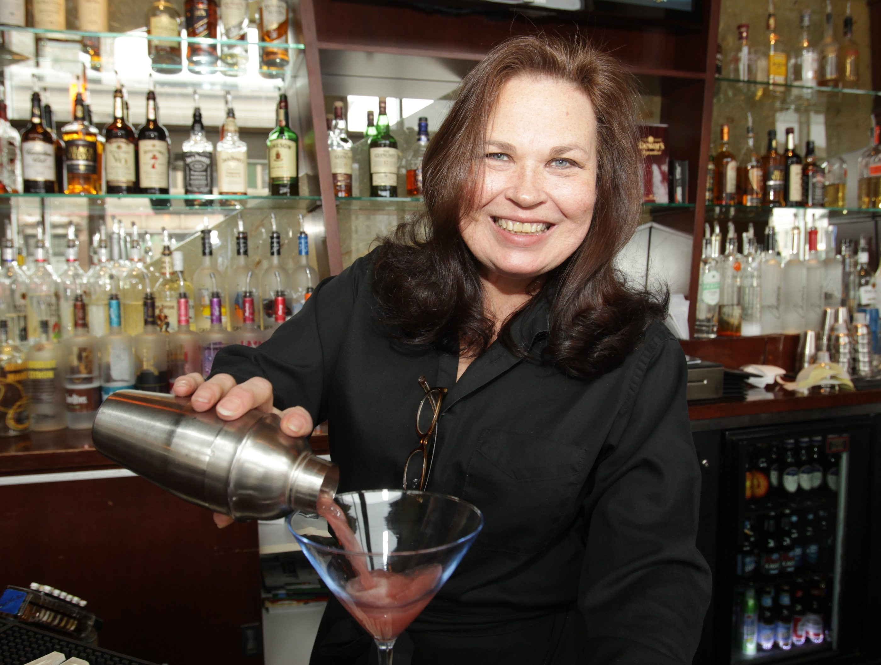 Kim Panzarella pours a martini, a specialty at Papaya.