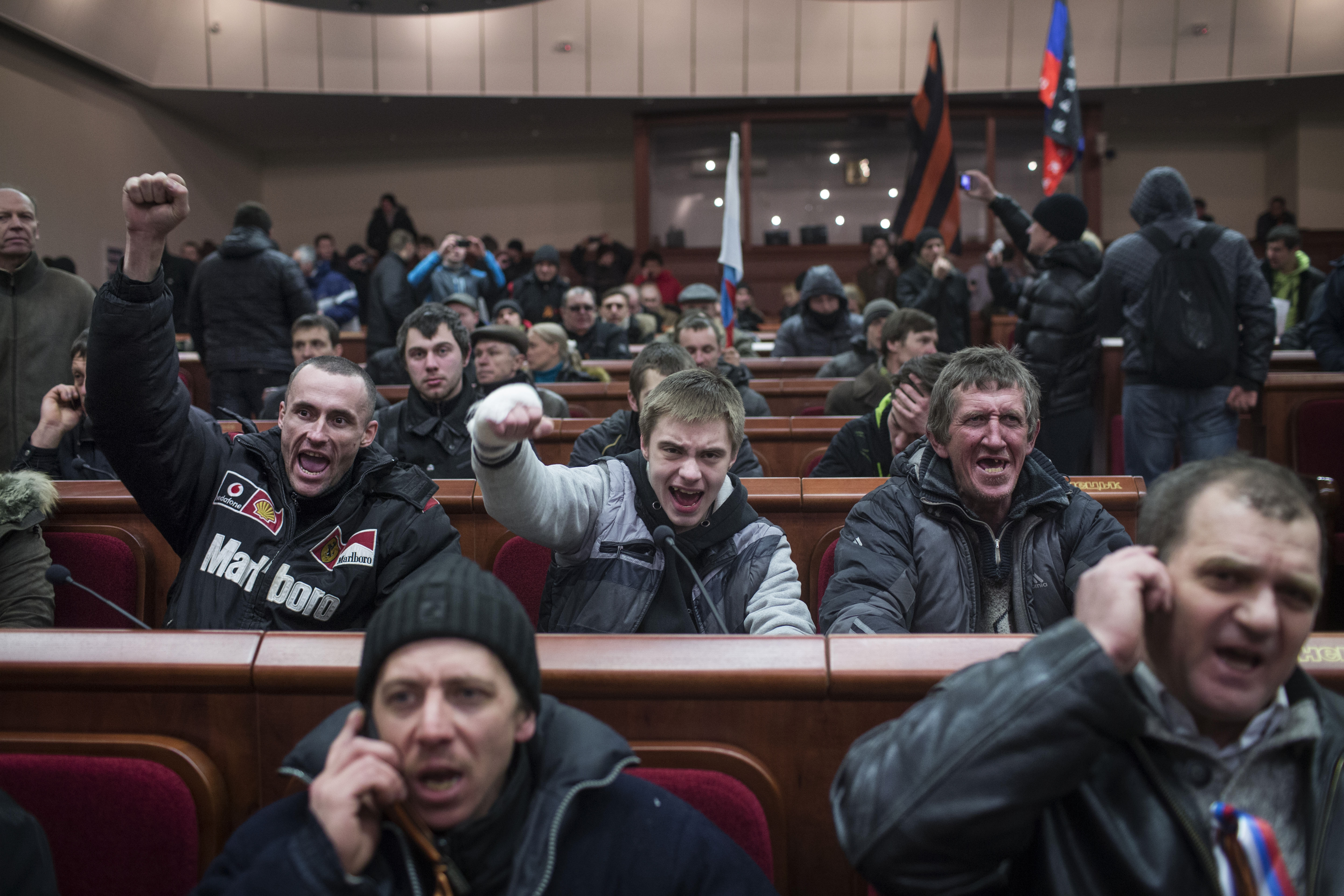 Pro-Russian protesters cheer during a takeover Monday of the regional parliament in the Donetsk, Ukraine.