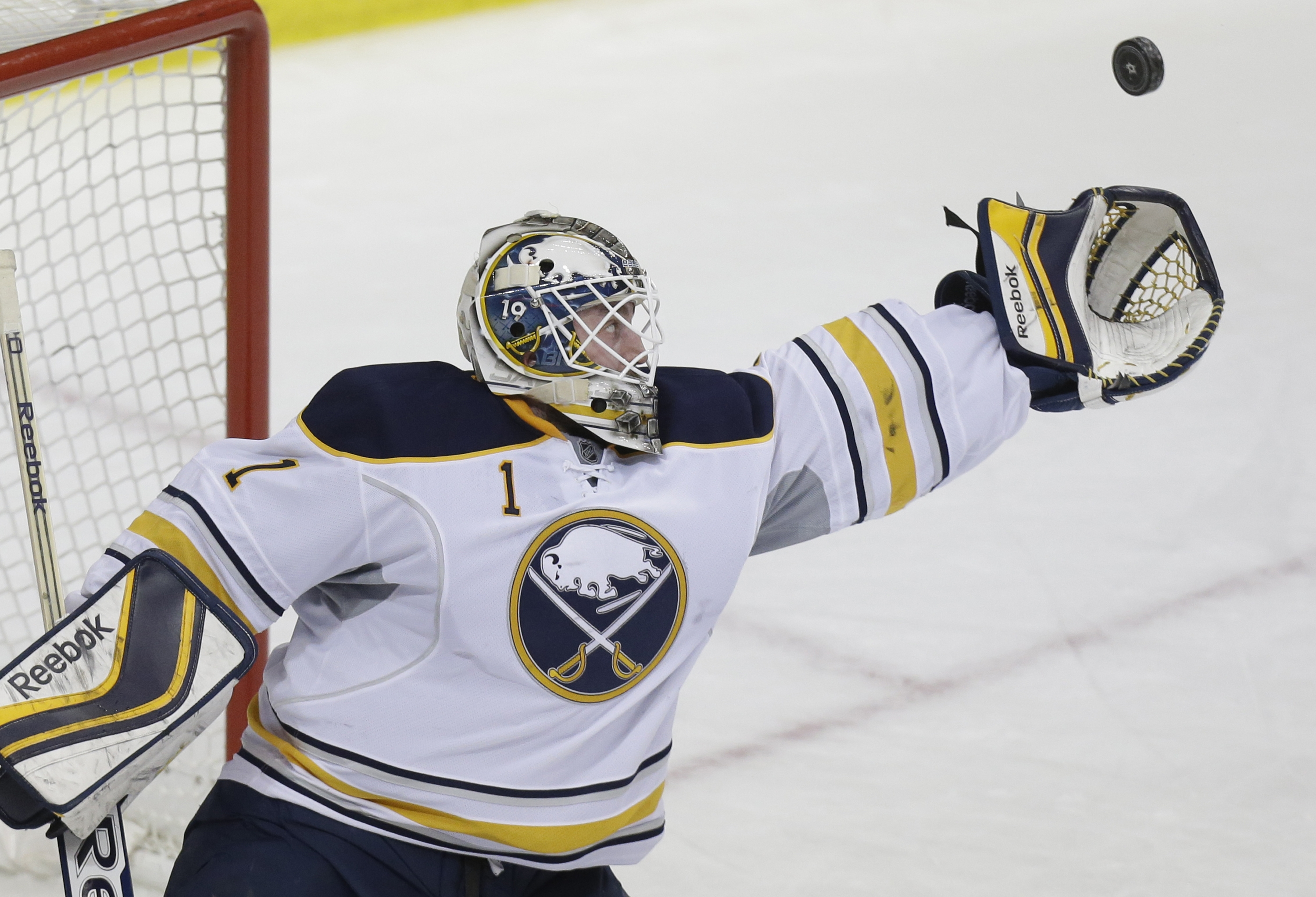 Sabres goalie Jhonas Enroth reaches to catch a shot during the first period in Dallas on Monday as he finished with 36 saves.