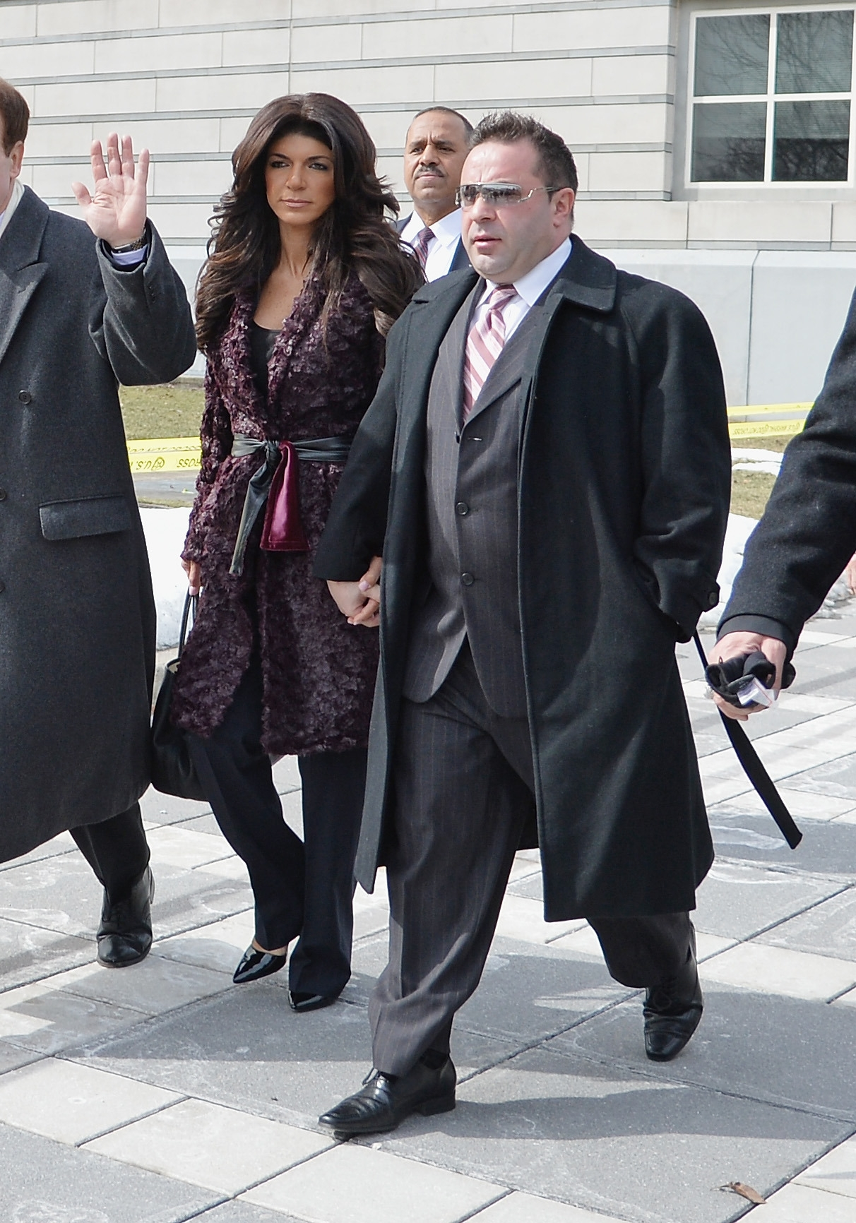 Reality show stars Teresa and Joe Giudice leave court in Newark, N.J., after pleading guilty to fraud charges.