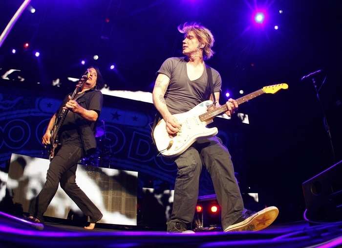 The Goo Goo Dolls – John Rzeznik (guitar, vocals), Robby Takac (bass, vocals), Mike Malinin (drums)-  are shown performing at Darien Lake Aug. 24. They'll play North Park Theatre on April 29. (Harry Scull Jr. / Buffalo News)