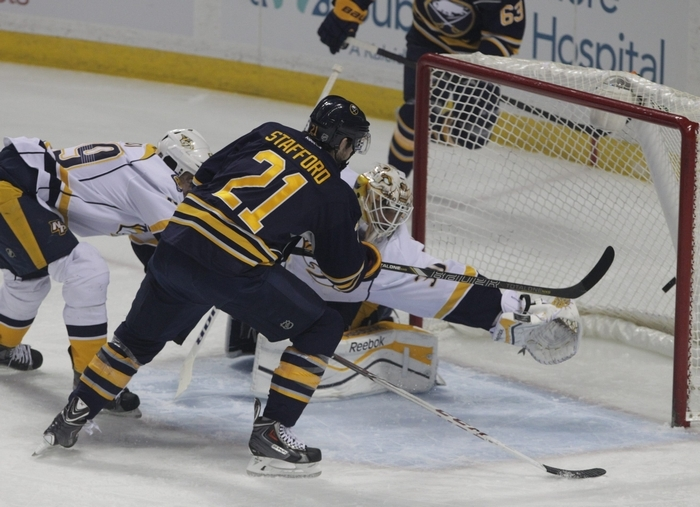 Drew Stafford (21) scores against Nashville goalie Carter Hutton to give Buffalo an early lead Tuesday night at First Niagara Center. (James P. McCoy/ Buffalo News)