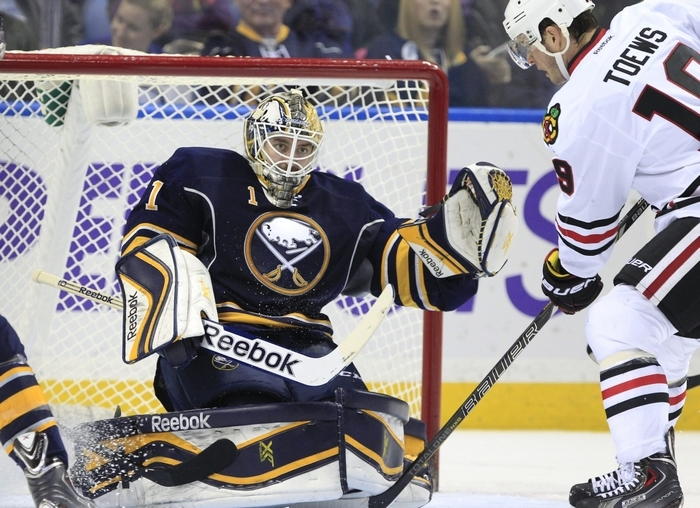 Jhonas Enroth makes one of his 29 stops here against Chicago captain Jonathan Toews but Toews got his revenge later in the game, scoring the game-winner early in the third period as the Sabres lost for the third time in four games. (Harry Scull Jr./Buffalo News)
