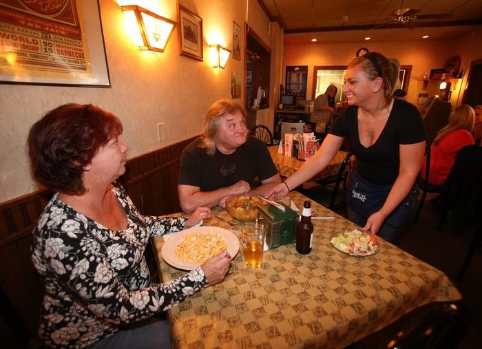 Server Sanannah Silvesti brings a Buffalo Chicken and Penne Pasta to Pam Shreve, of Cheektowaga, left, and a taco salad to her husband Roy Shreve at the Nickel Creek CafÈ on Clinton St. in West Seneca Saturday, Oct. 5, 2013.  (Robert Kirkham/Buffalo News)