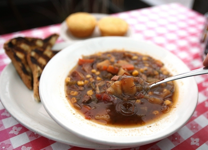 Bowl of Brunswick stew, with accompanying Texas toast and cornbread at Kentucky Greg's in Depew.  (Robert Kirkham/Buffalo News)