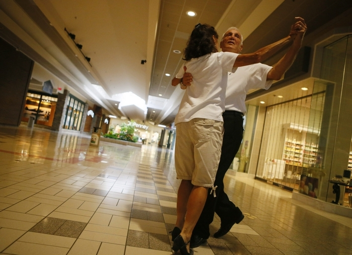 Tony Pegnia Sr. and his wife Laura practice ballroom dancing at the Eastern Hills Mall early one morning. (Derek Gee/Buffalo News)