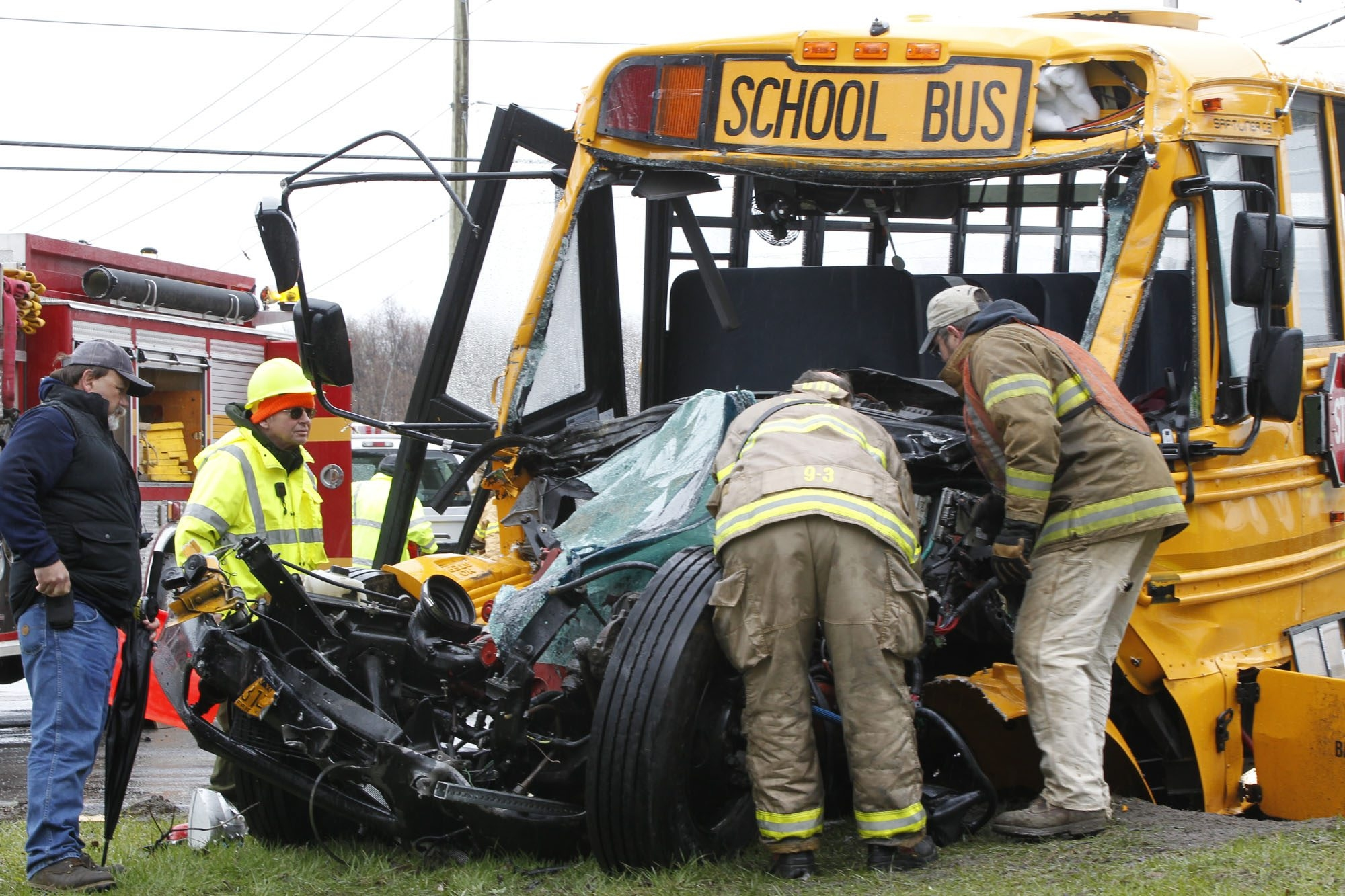 Rescue crews work to free school bus driver Marlene Golabek from the wreckage of a crash in the Town of Concord,  Wednesday. Her bus hit a tractor-trailer that had failed to stop at a stop sign.