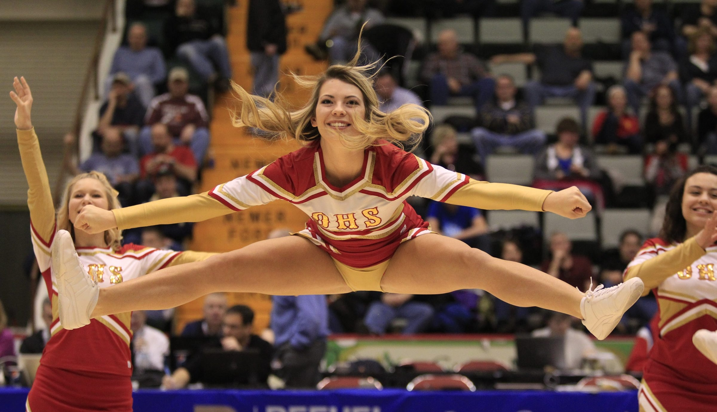 Olean High School cheerleaders perform during a basketball playoff game last month.