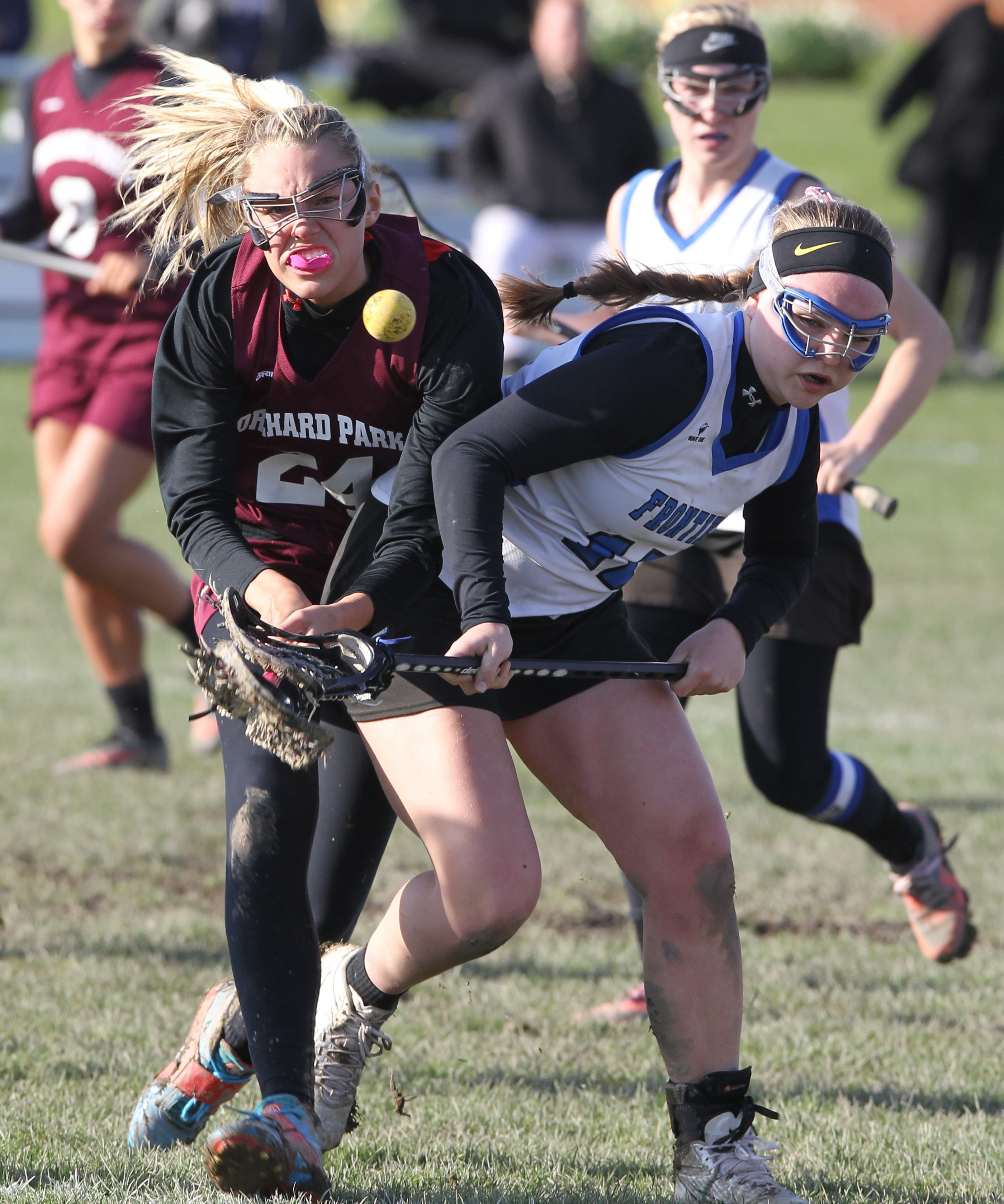 Jackie Dufresne, right, beats Orchard Park's Sydney Potenza to the ball in their game on Tuesday at Frontier.