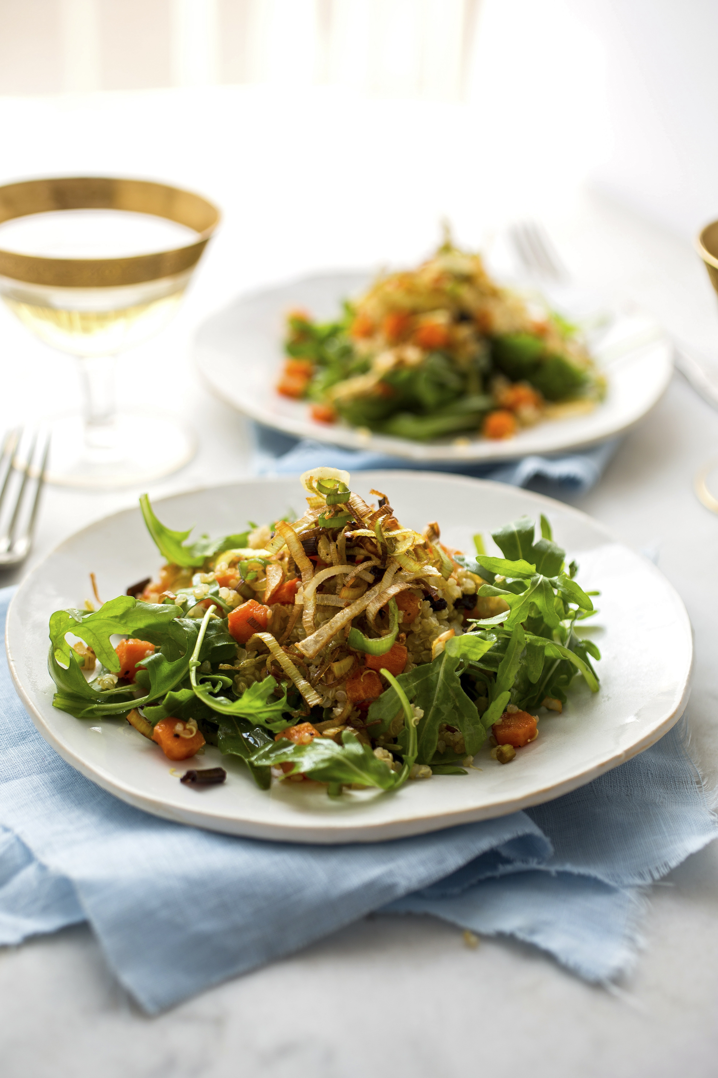 Quinoa salad with roasted carrots and frizzled leeks also includes currants, arugula and a pomegranate dressing.