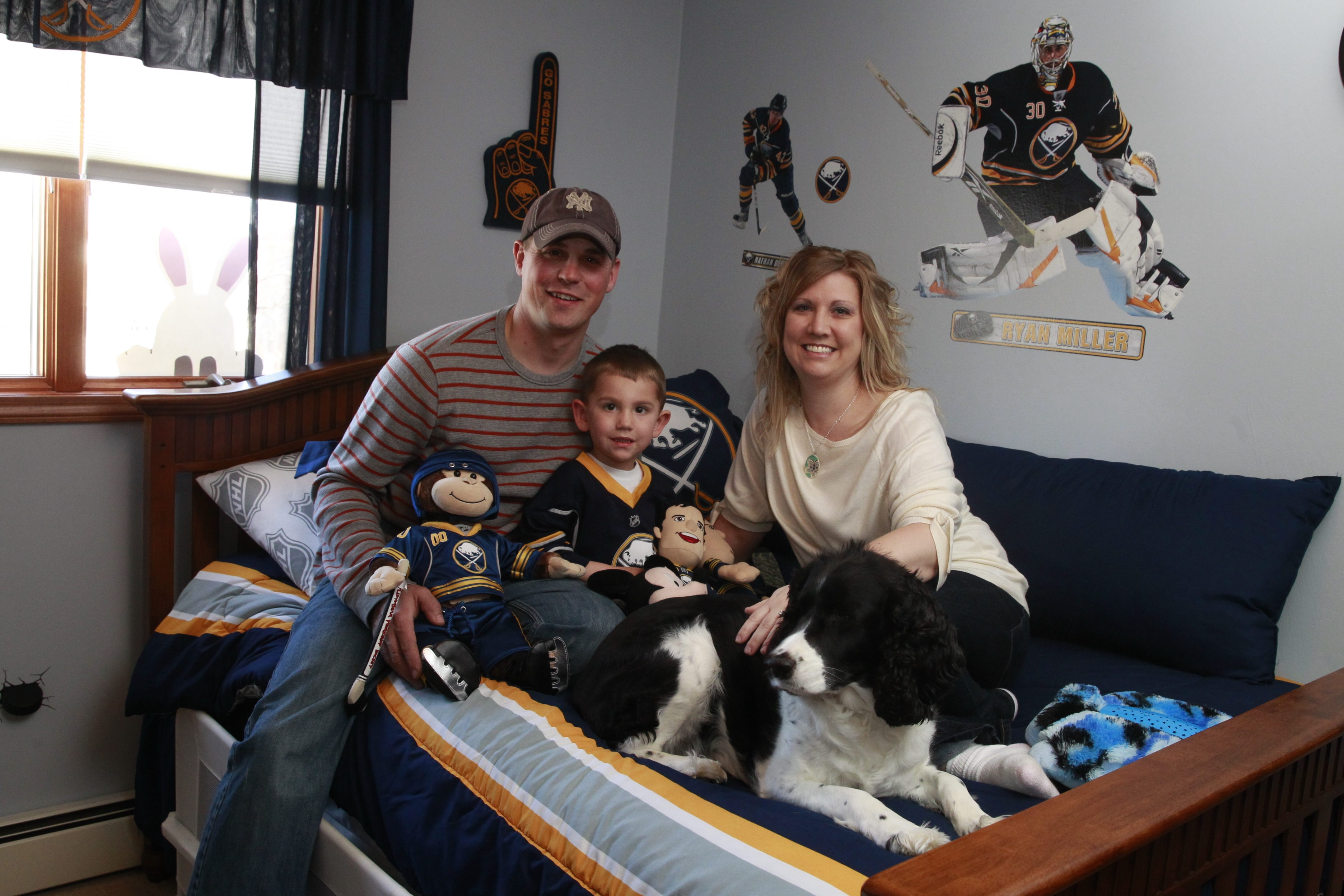 Scott and Kelly Glinski sit with their son, Ryan, 3. Ryan was born without the cells in his large intestine that allow food to move through the digestive tract. His disease is often fatal.