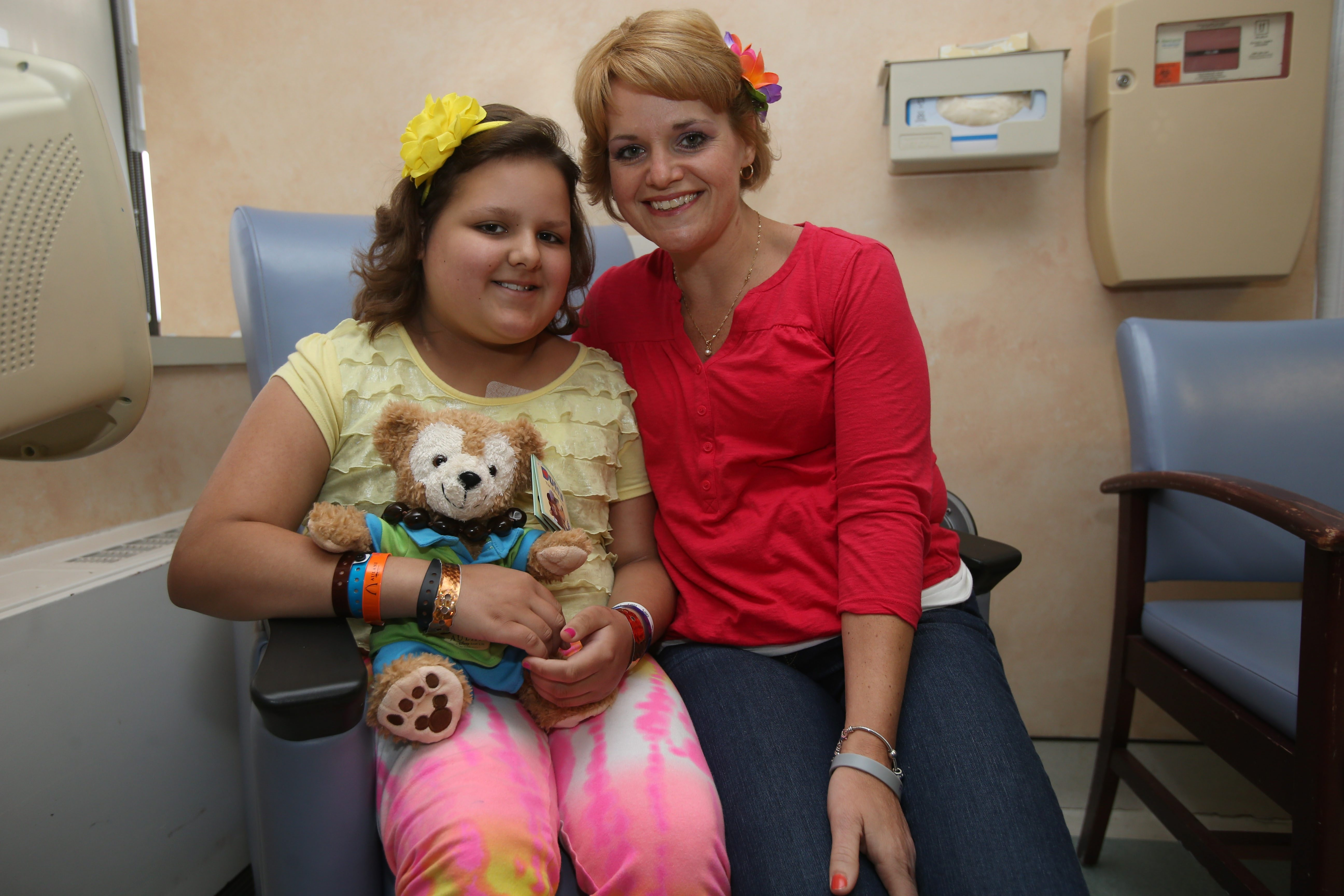 Caralyn Reynolds, 9, of Grand Island, sits with her mother, Jennifer, in the Infusion Unit at Women & Children's Hospital, where they come every Monday.