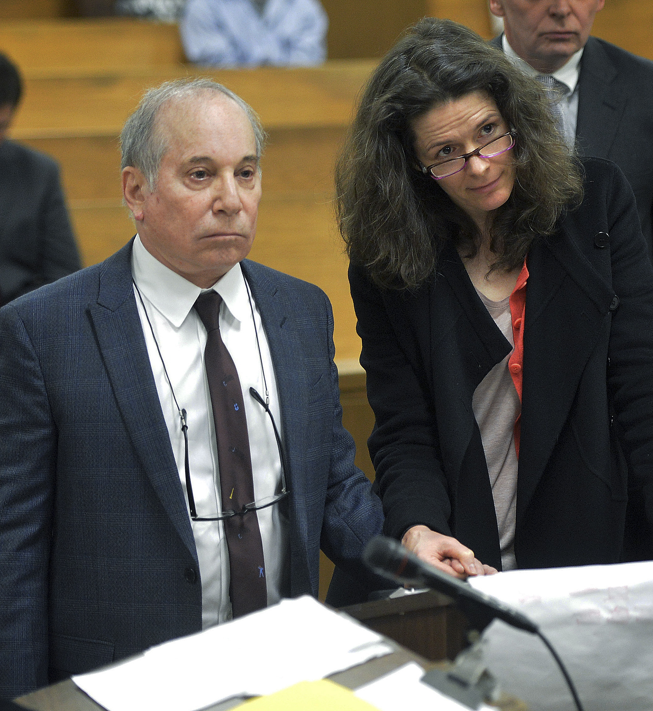Singer Paul Simon, left, holds hands with his wife, Edie Brickell, in court after the couple were arrested for disorderly conduct after a fight at their home in Connecticut.