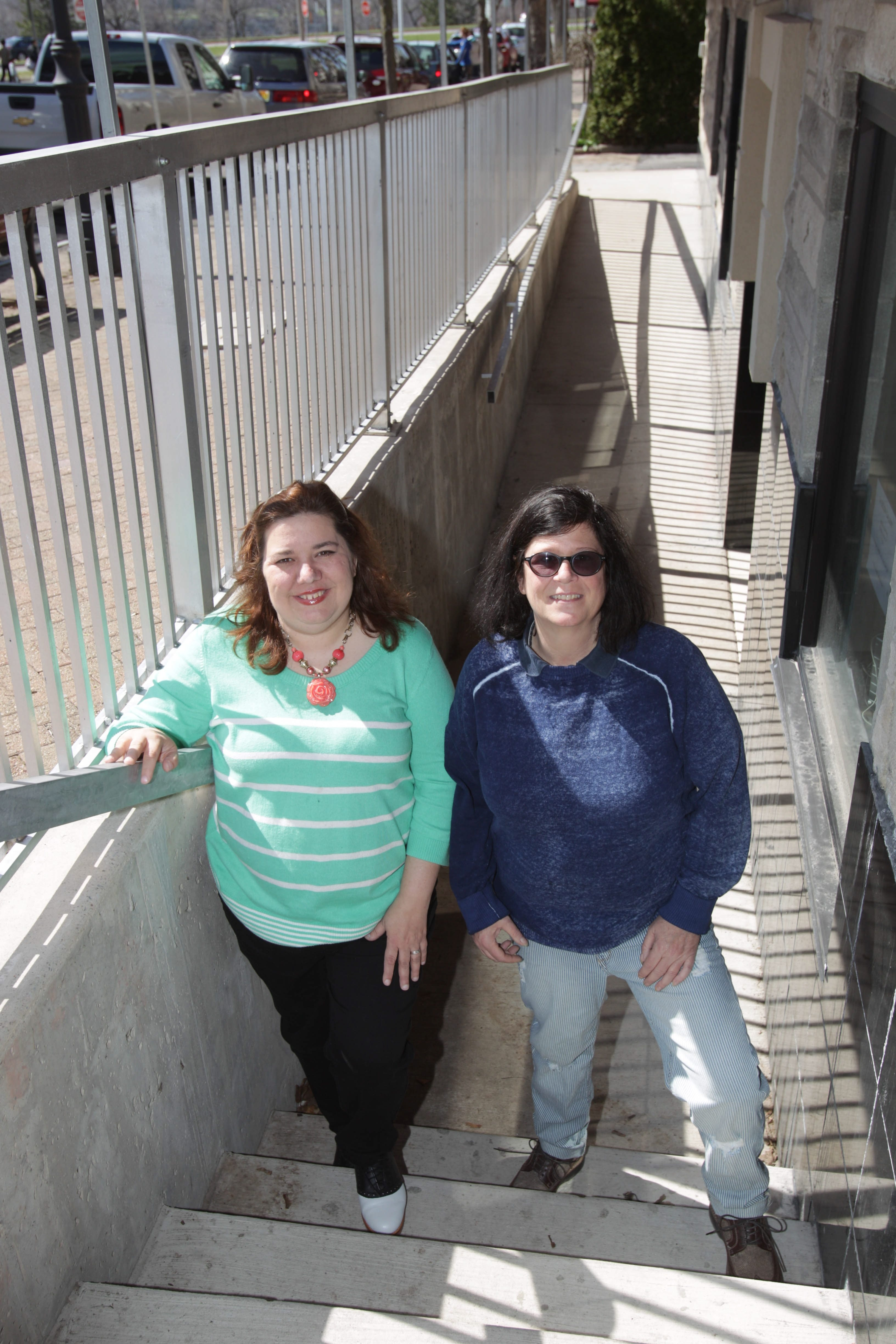 Andrea, left, and Tina Galyn stand outside the entrance of the 24 Below Galley & Cafe on Thursday.