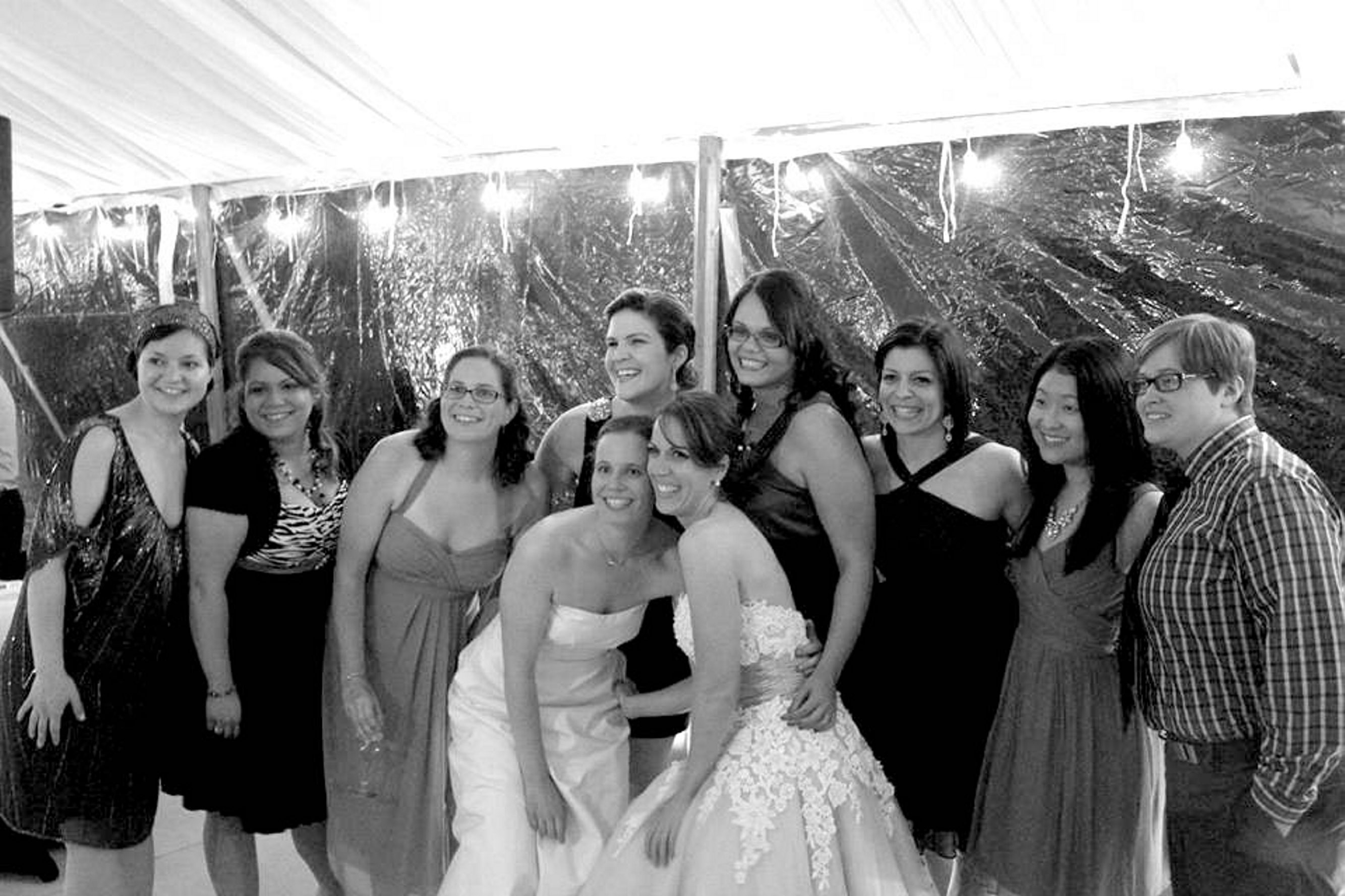 Newlyweds Lynn Zlotkowski, left, and Lisa Hardej are shown at their wedding reception surrounded by Sacred Heart graduates and family. The private Buffalo school refused to put news of Zlotkowski's wedding in the alumni publication.