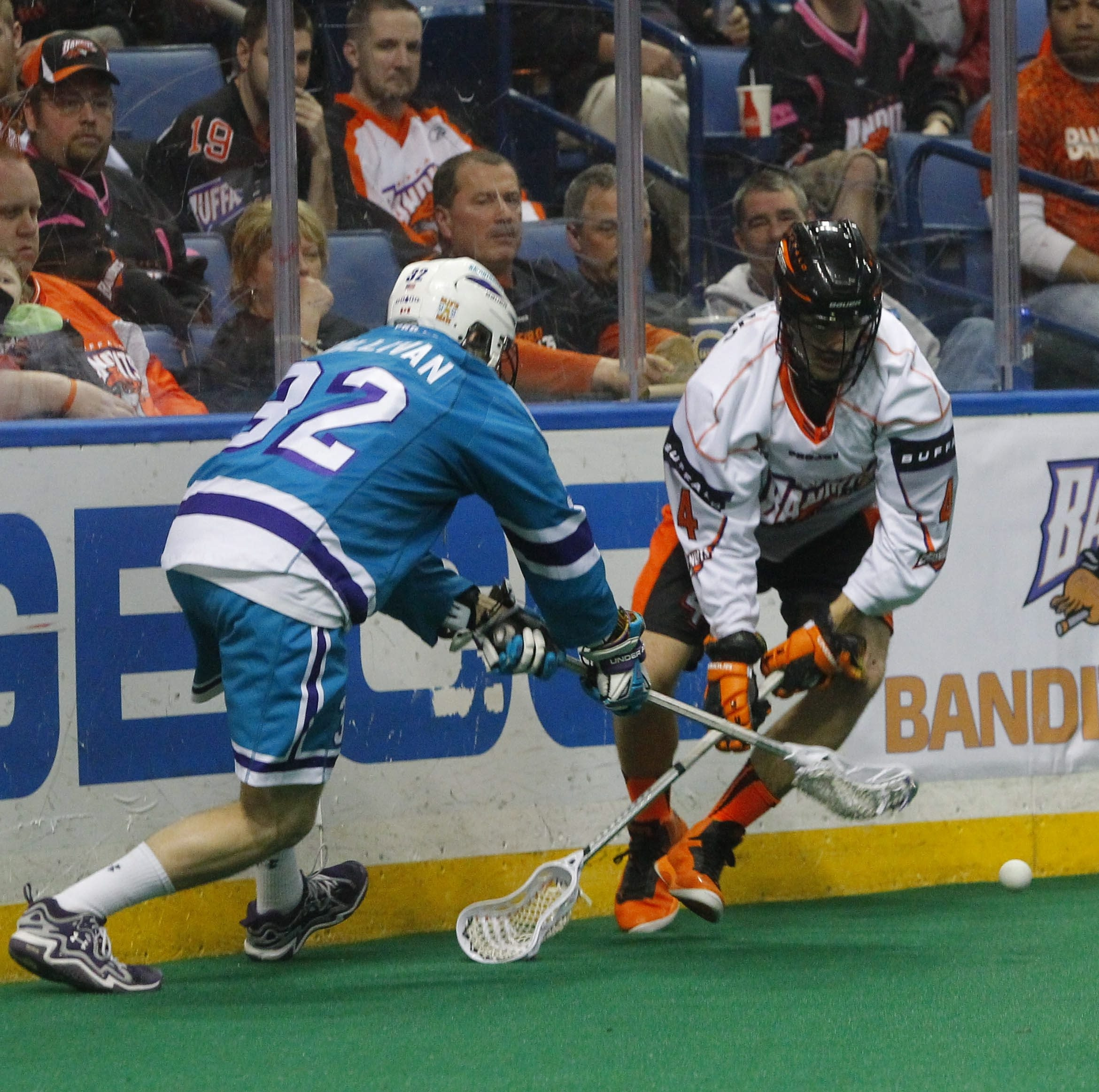 Bandits' Joel Matthews (4) and Knighthawks' Jon Sullivan (32) go for the ball in the regular-season finale at First Niagara Center Saturday.