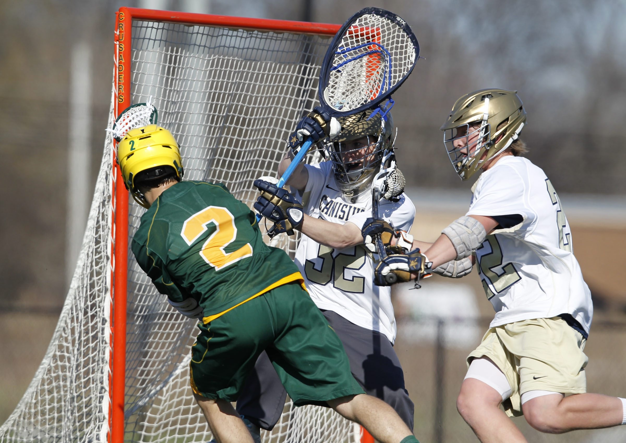 Bishop Timon-St. Jude's Layne Collins scores on Canisius goalie Andrew Cleary during the Tigers' 22-6 win on Thursday.