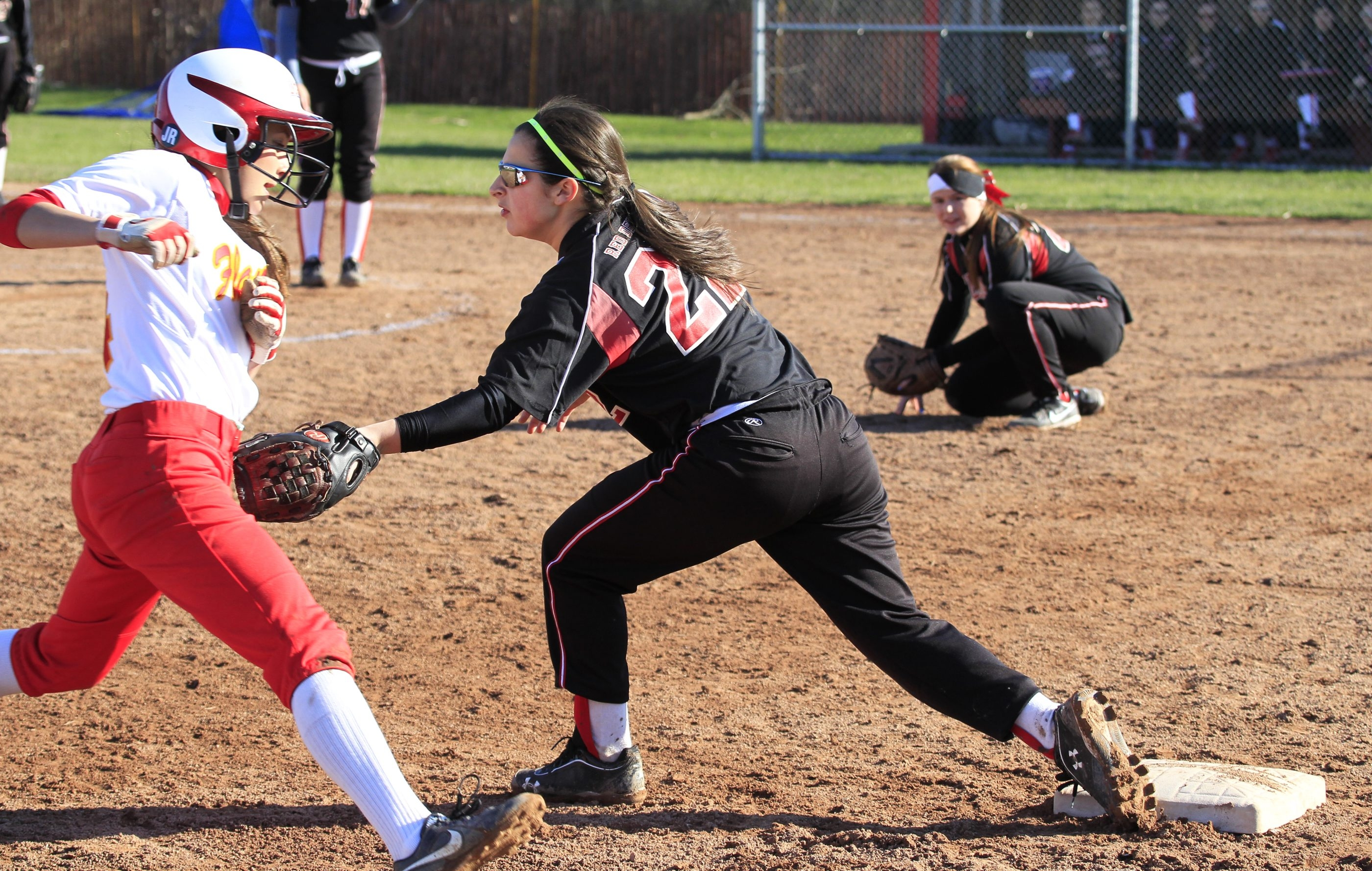 Clarence third baseman Gabby Keller tags Williamsville East's Marissa Birzon as she attempted to steal third base. Clarence won the game, 16-2.