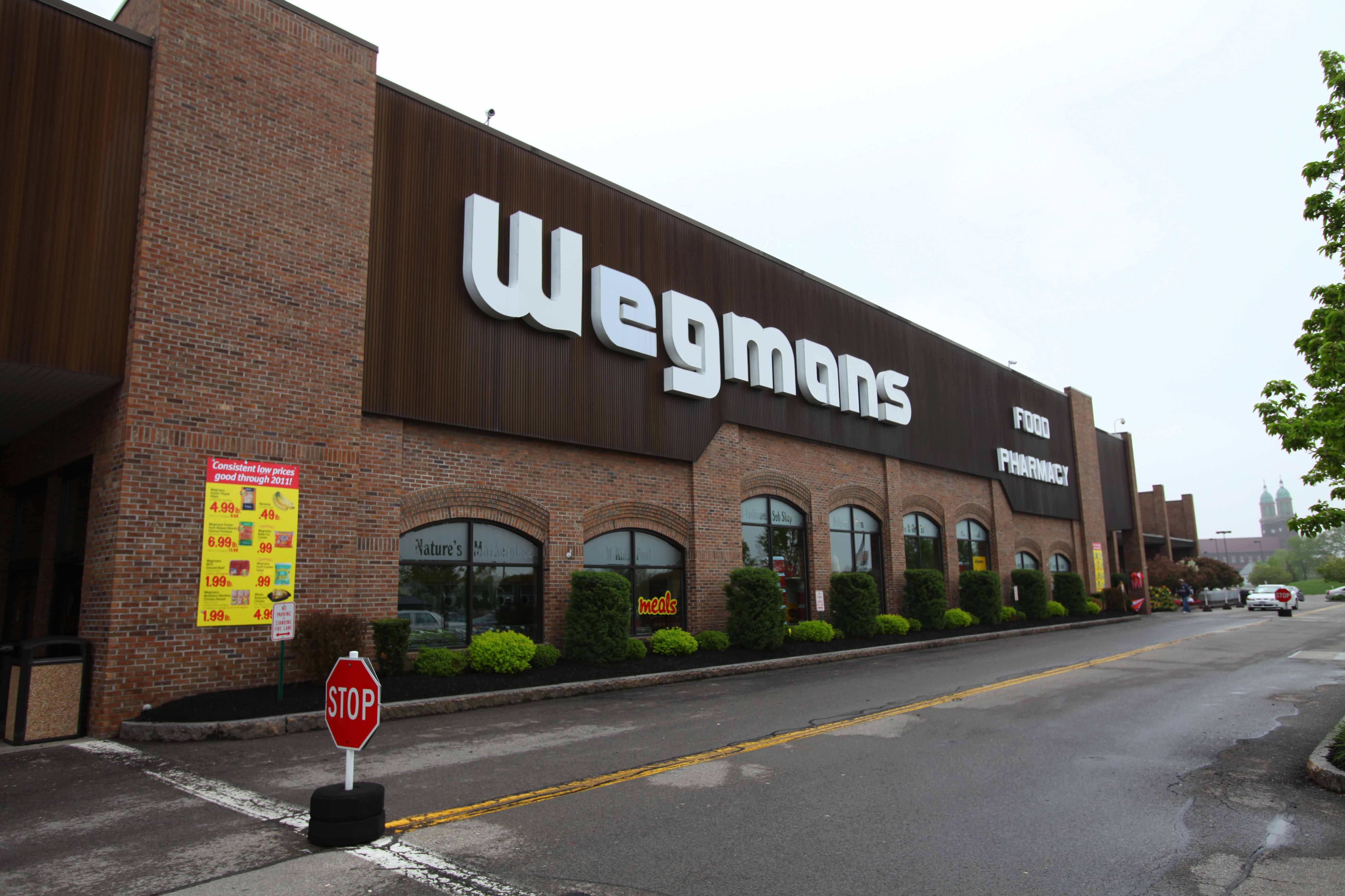 A liquor store co-owned by Nicole Wegman is to open soon in front of this Wegmans supermarket on Amherst Street in North Buffalo.