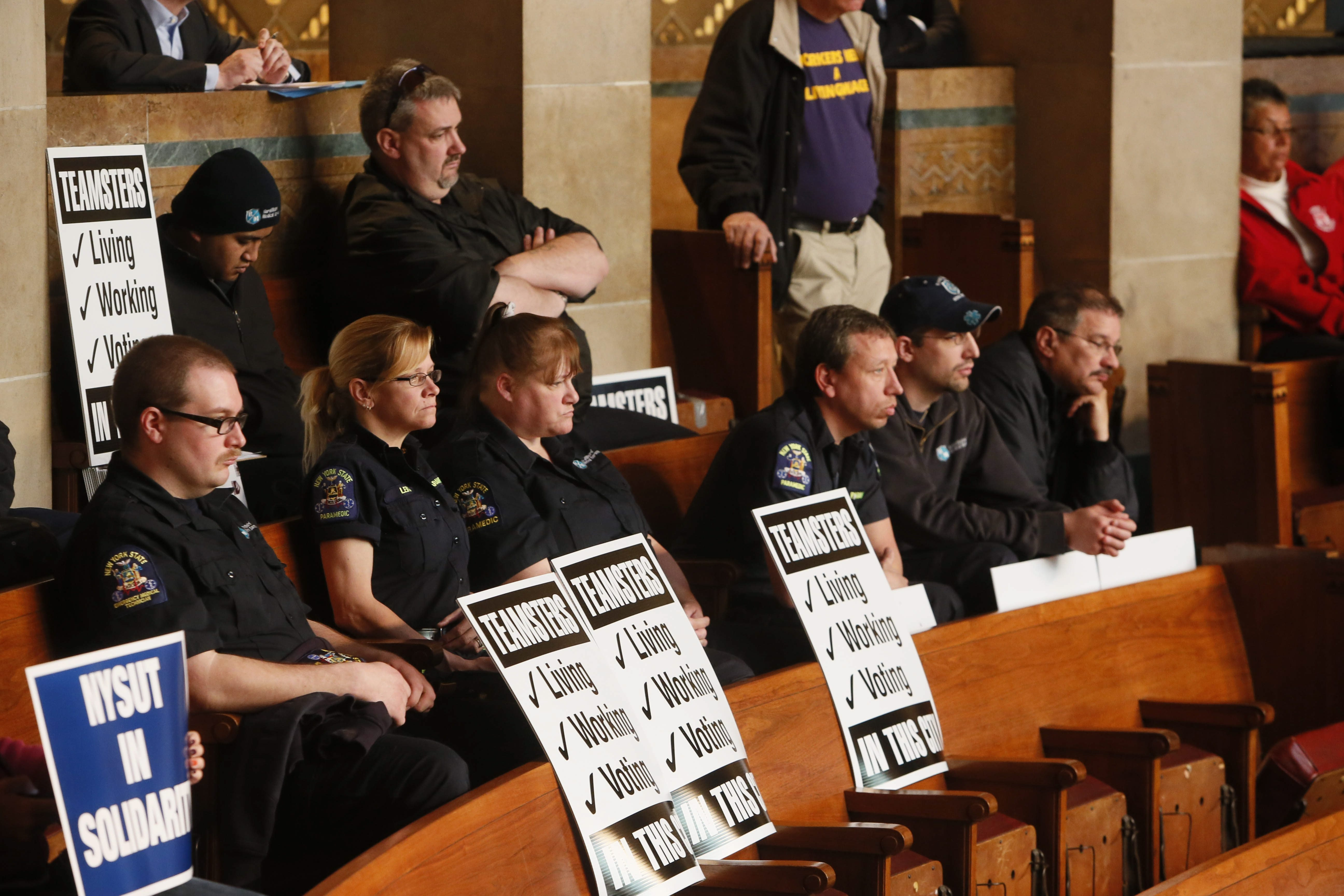 About 35 Rural/Metro employees and Teamster union members were in City Hall Tuesday, urging the city to retain Rural/Metro as the city's ambulance provider.