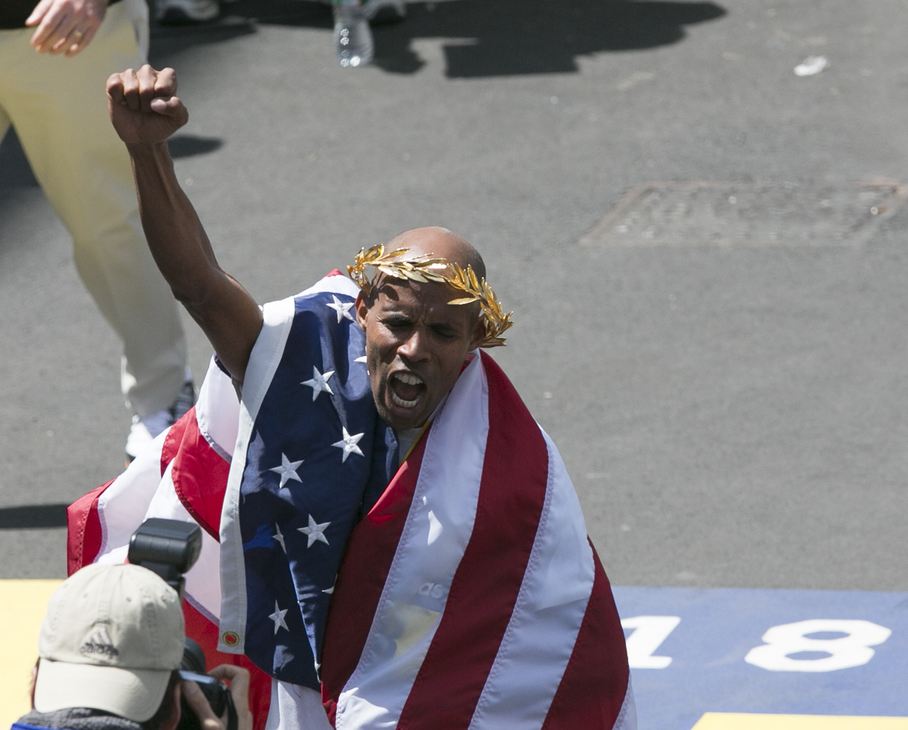 Meb Keflezighi of the U.S. celebrates after winning the men's race of the Boston Marathon,He is the first American to win the men's race since 1983. (Katherine Taylor/The New York Times)