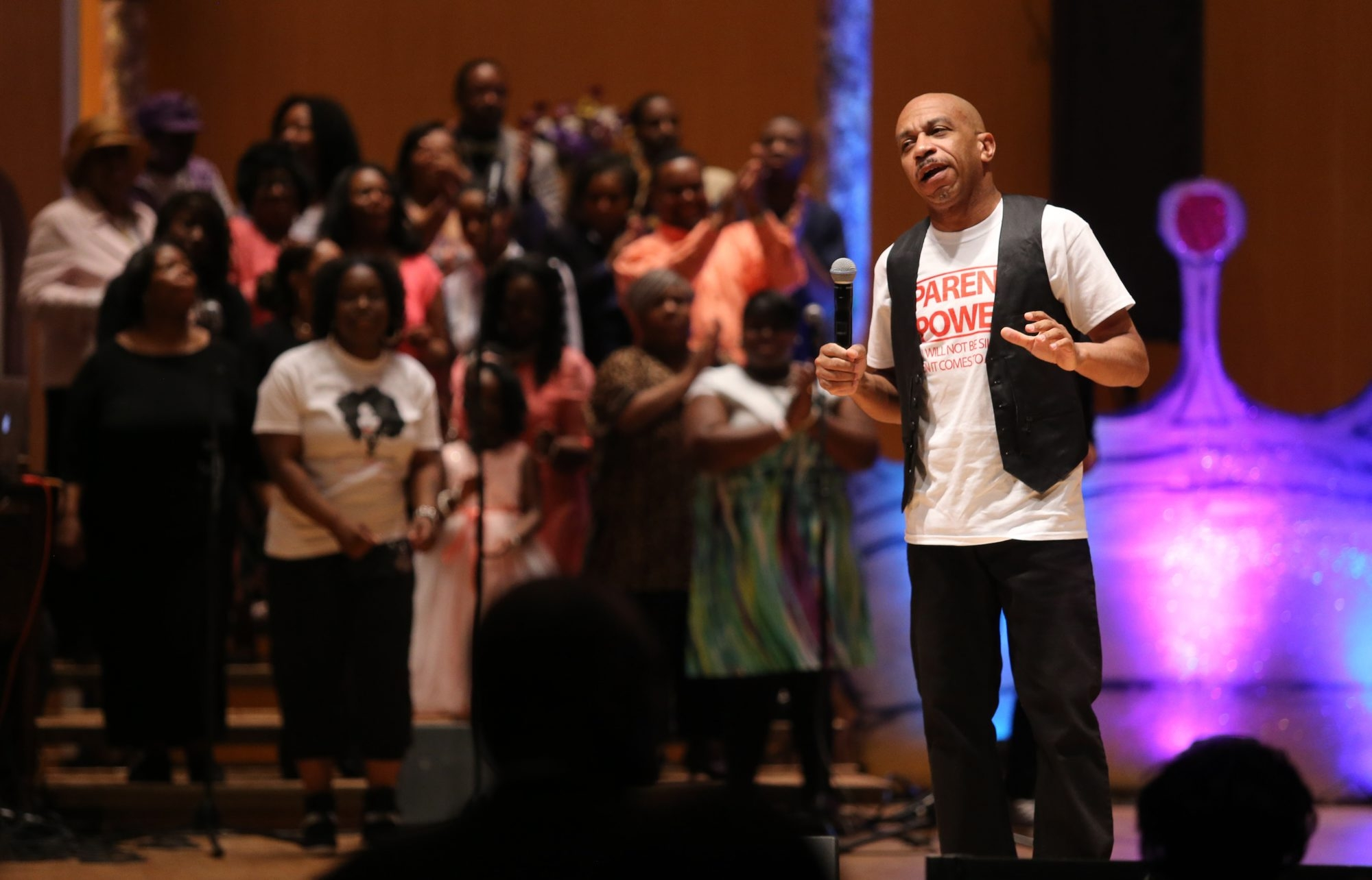 The Rev. Darius Pridgen addresses the crowd from the stage at Kleinhans Music Hall during a special True Bethel Baptist Church Easter Celebration on Sunday.