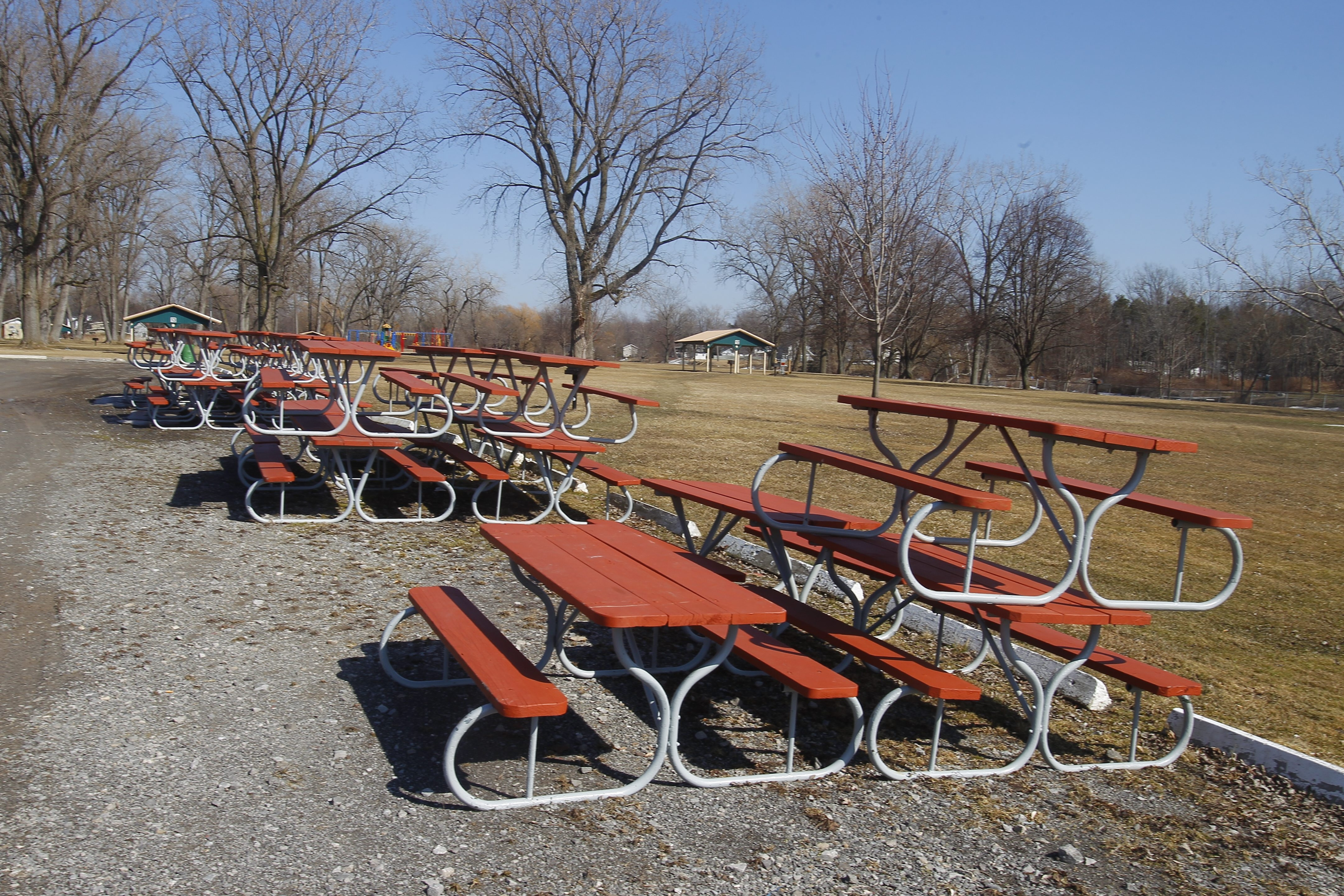 Stacked picnic benches outdoors on 46-degree day at West Canal Marina in North Tonawanda in early April. Conditions should improve in time for the many events.