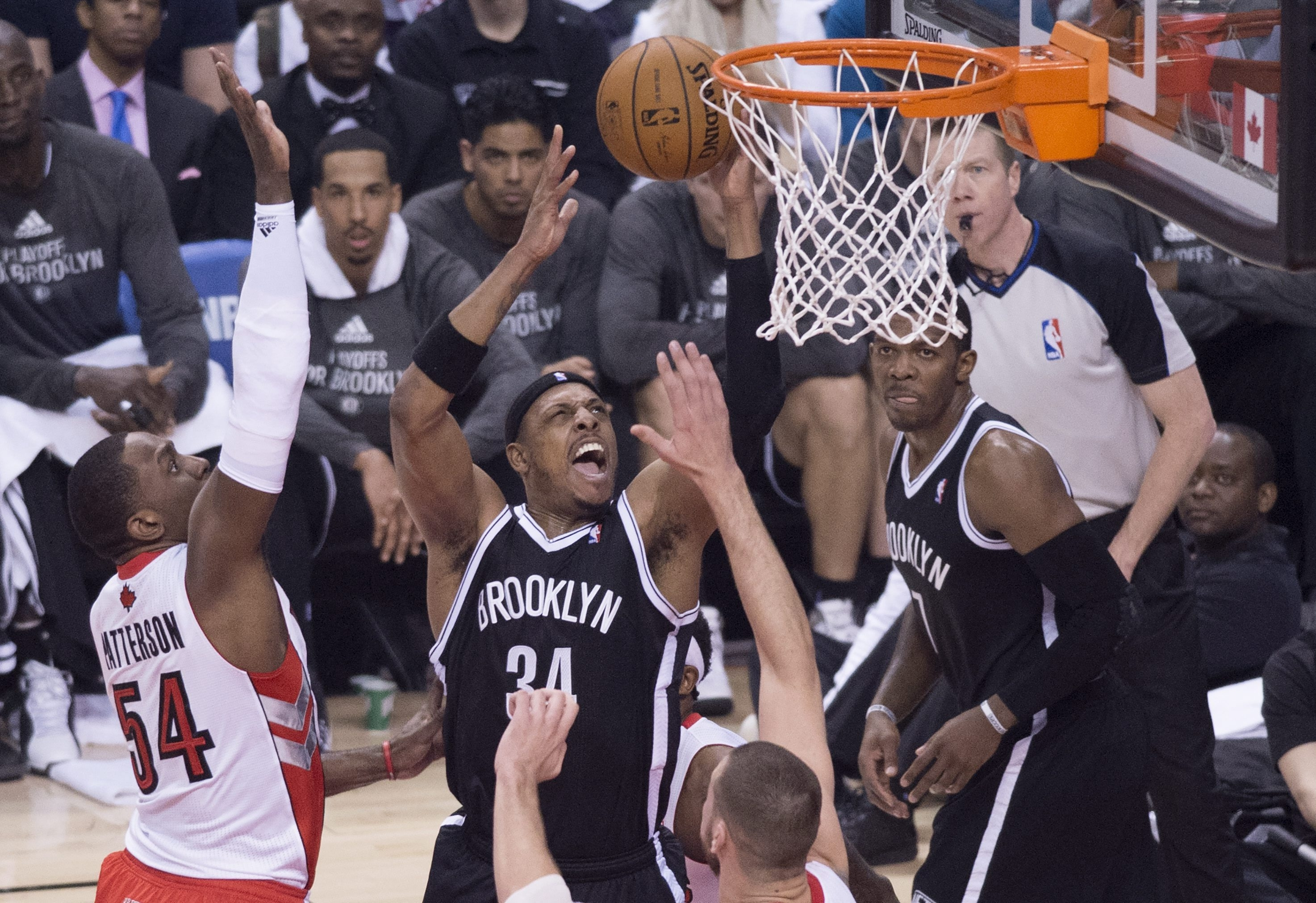 Brooklyn's Paul Pierce took control down the stretch to help the Nets grab the playoff series opener against Toronto.