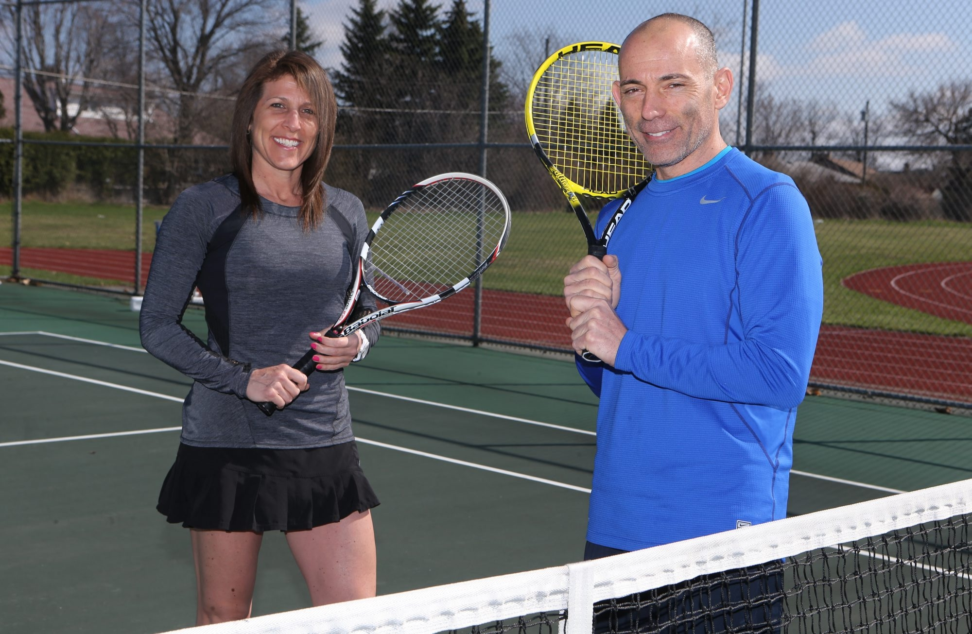 Mixed doubles tennis champs Cheryl O'Connell and Dan DiPirro have a high winning percentage.