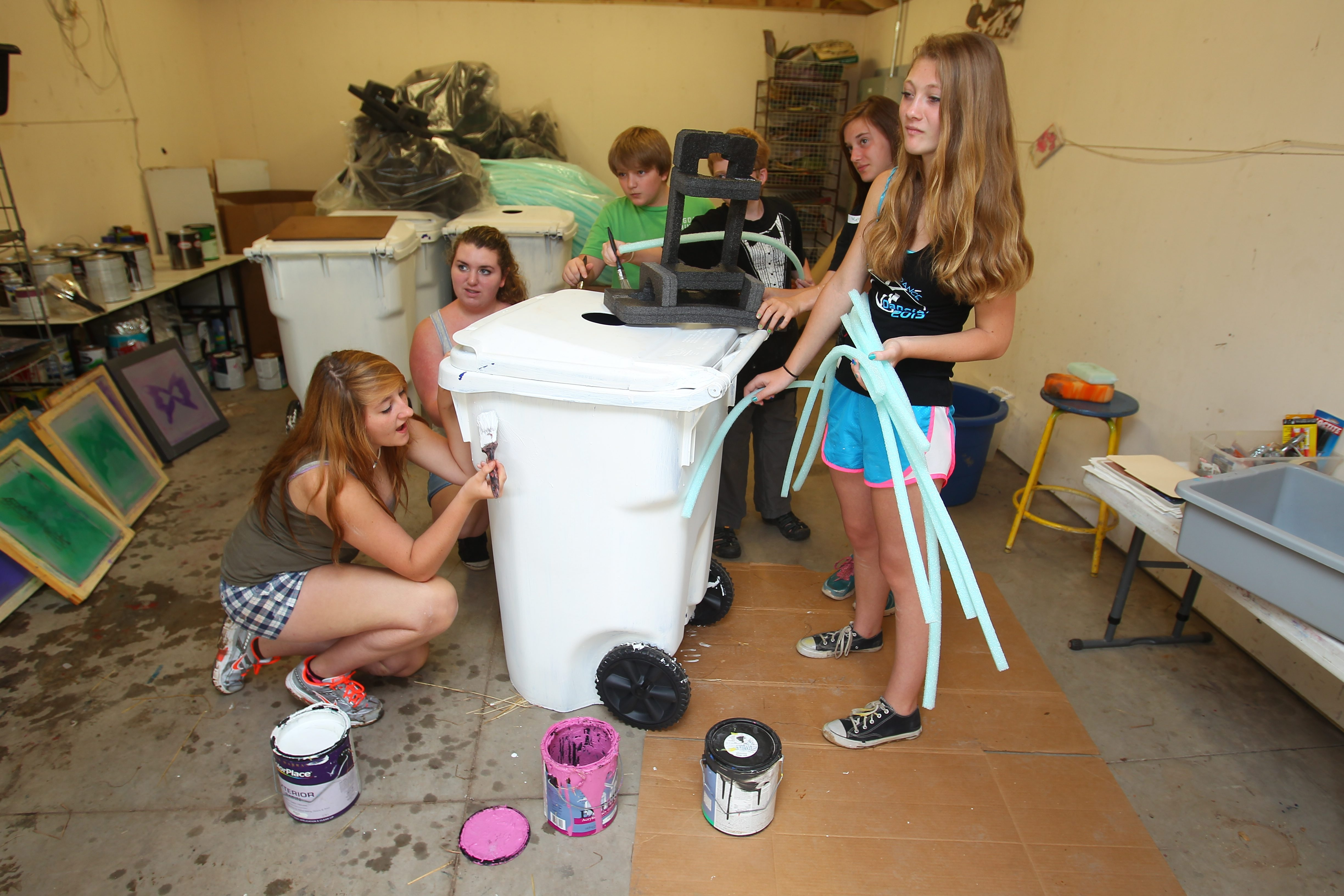 Family oriented programming at Artpark includes summer camp for children. Last year these kids painted garbage/recycle cans for the Lewiston Arts Festival. (Buffalo News file photo)