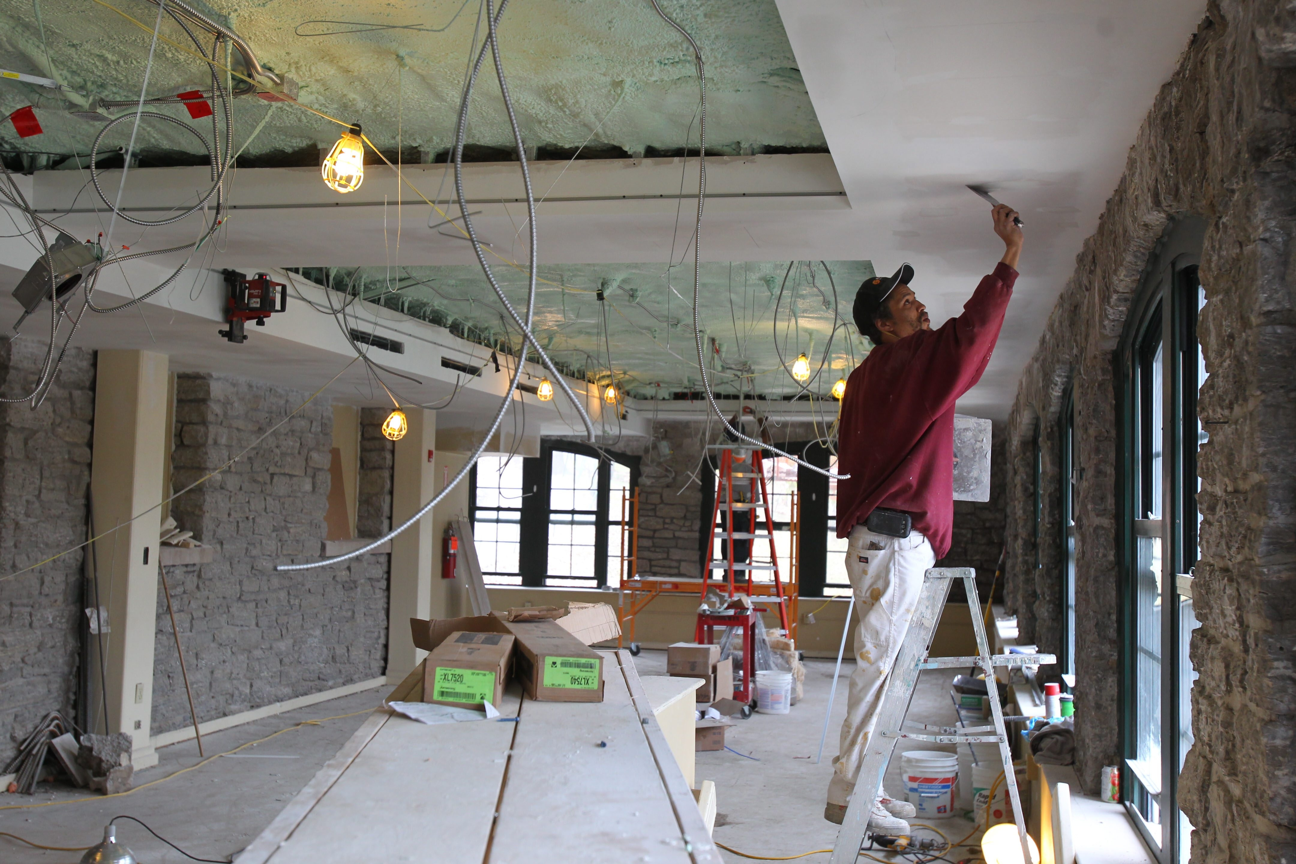 Tyrone Worthy of OCM Construction finishes some drywall as part of the improvements at Marcy Casino in Delaware Park on Friday. See a photo gallery at BuffaloNews.com.