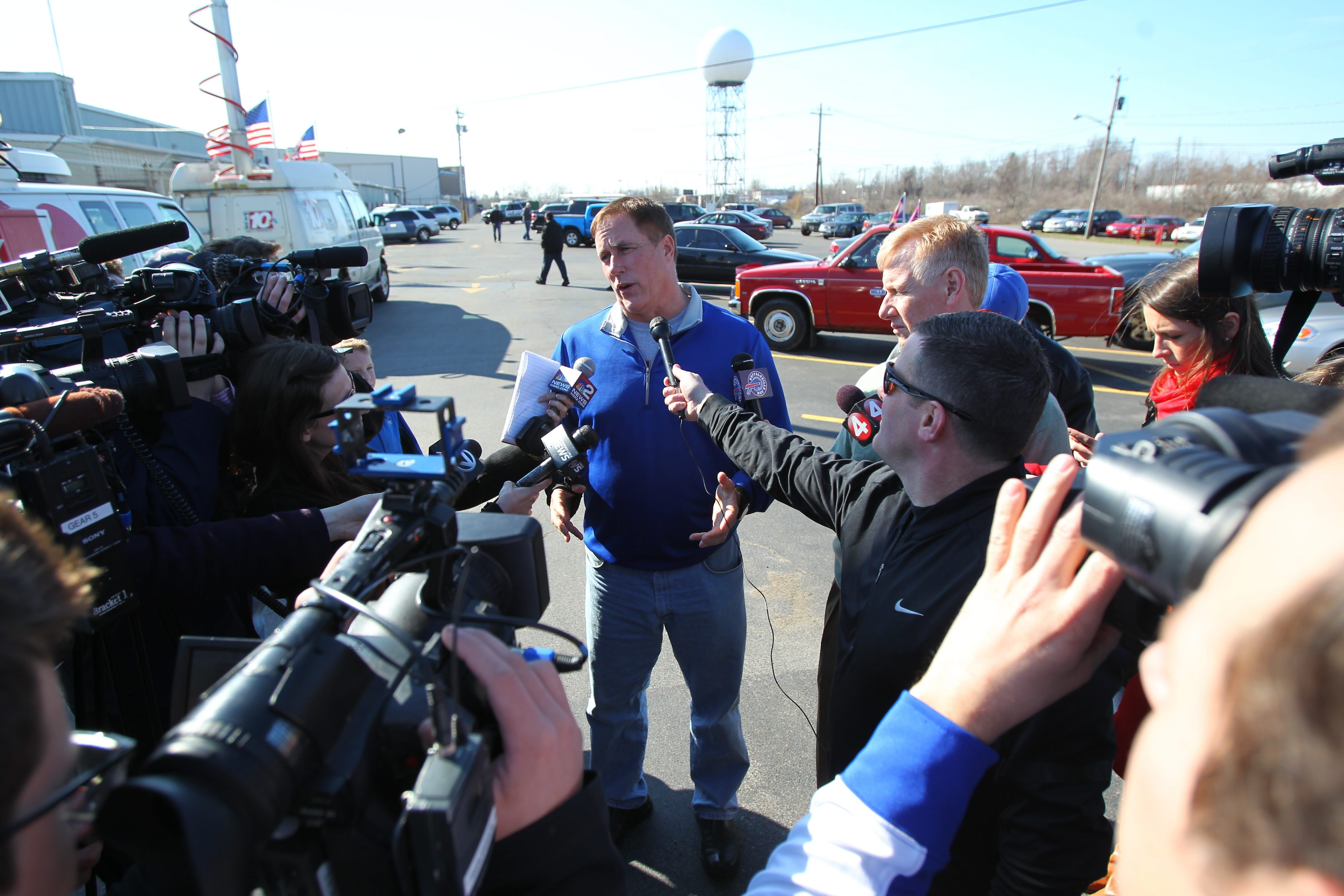 Dan Kelly, Jim Kelly's brother, addresses the media at Prior Aviation where the Hall of Famer was supposed to arrive.