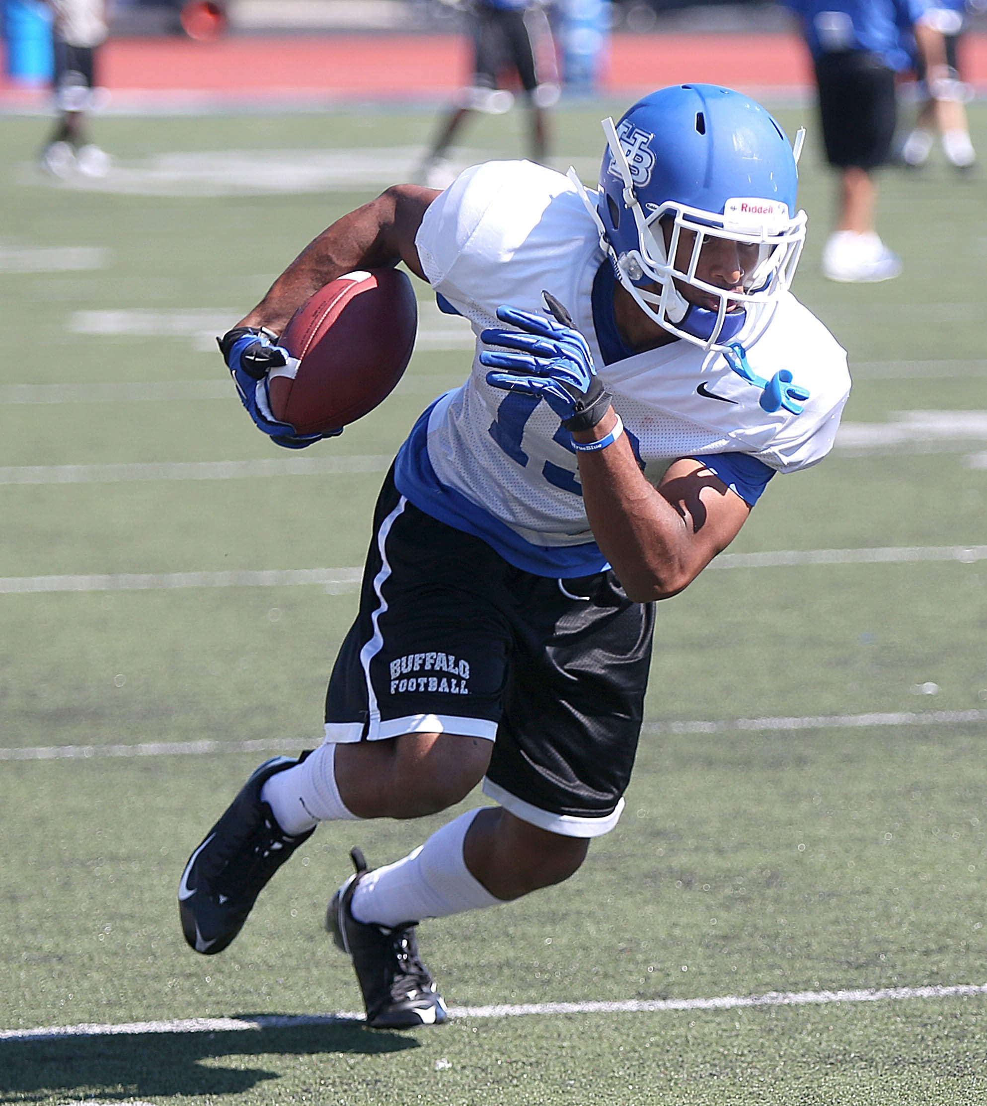 Wide receiver Devon Hughes (13) finds some open field during receiver drills at University at Buffalo Bulls football practice at UB North on Friday, Aug. 23, 2013.  (Robert Kirkham/Buffalo News)
