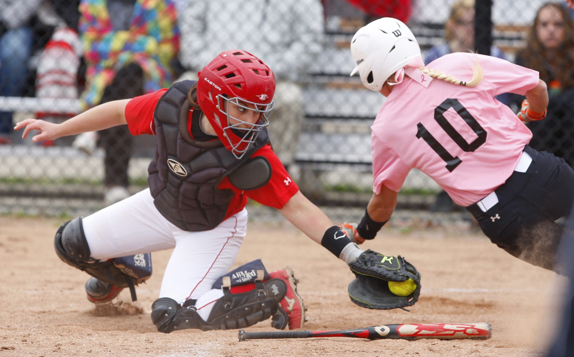 Buffalo State's Carly Knight (Lew-Port) avoids the tag in a doubleheader loss to Cortland. The Bengals wore pink uniforms to help raise money to assist in the battle against cancer. See photo gallery at buffalonews.com