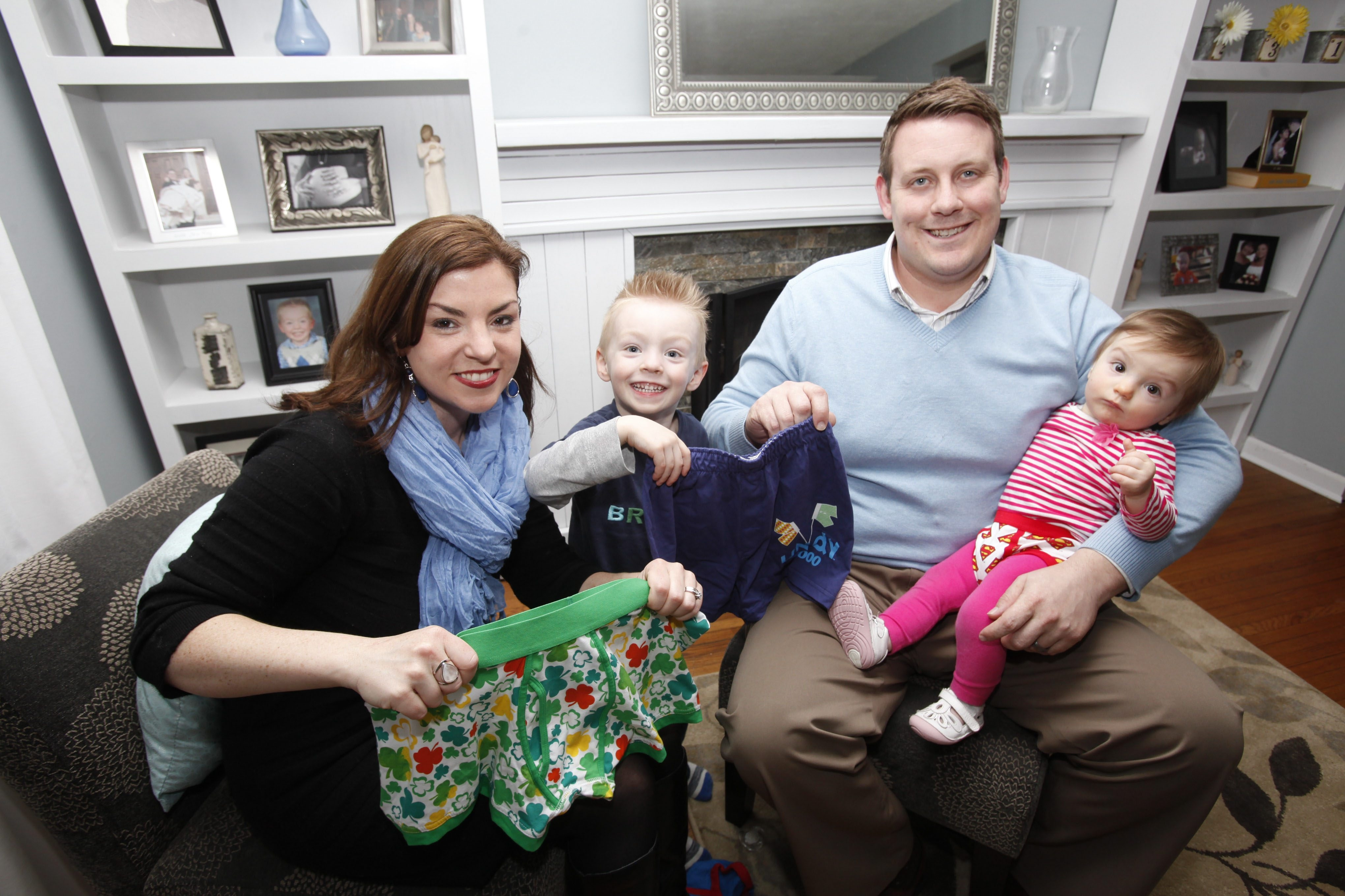 Tess Fraser, with son Patrick, daughter Evelyn and husband Don, hold underwear to promote the Undy 5000, a race to raise colon cancer awareness.