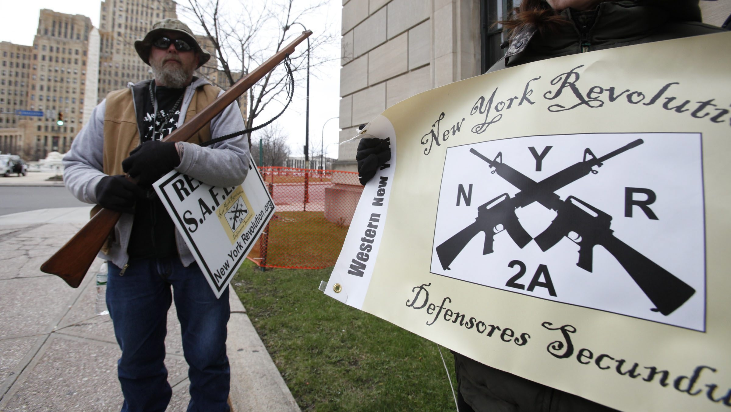 Demonstrators in Niagara Square vowed not to obey the SAFE Act. Sheriff Howard should not make the same promise. (Harry Scull Jr./Buffalo News)