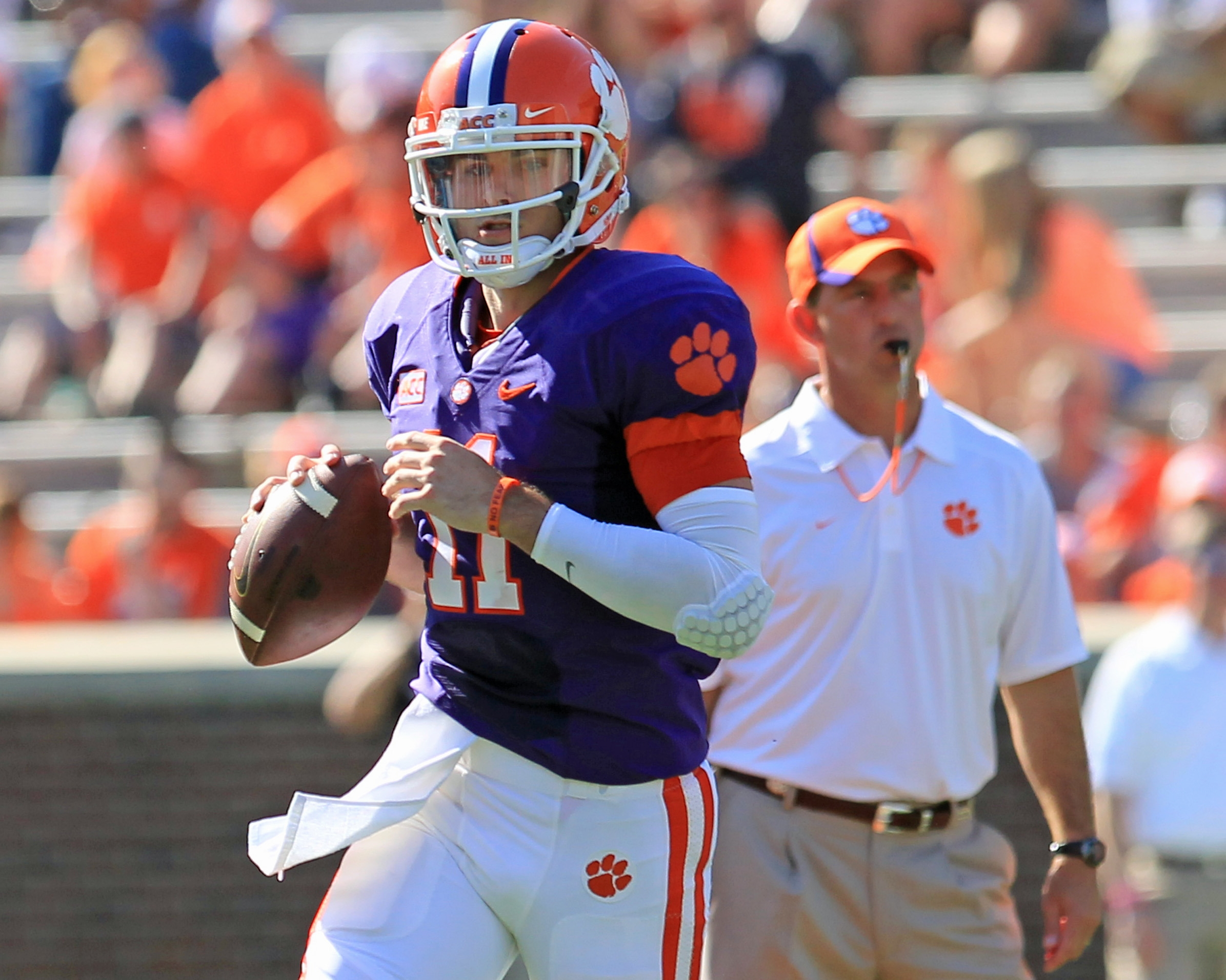 Quarterback Chad Kelly runs a play in front of Clemson head coach Dabo Swinney during the spring game on April 12.