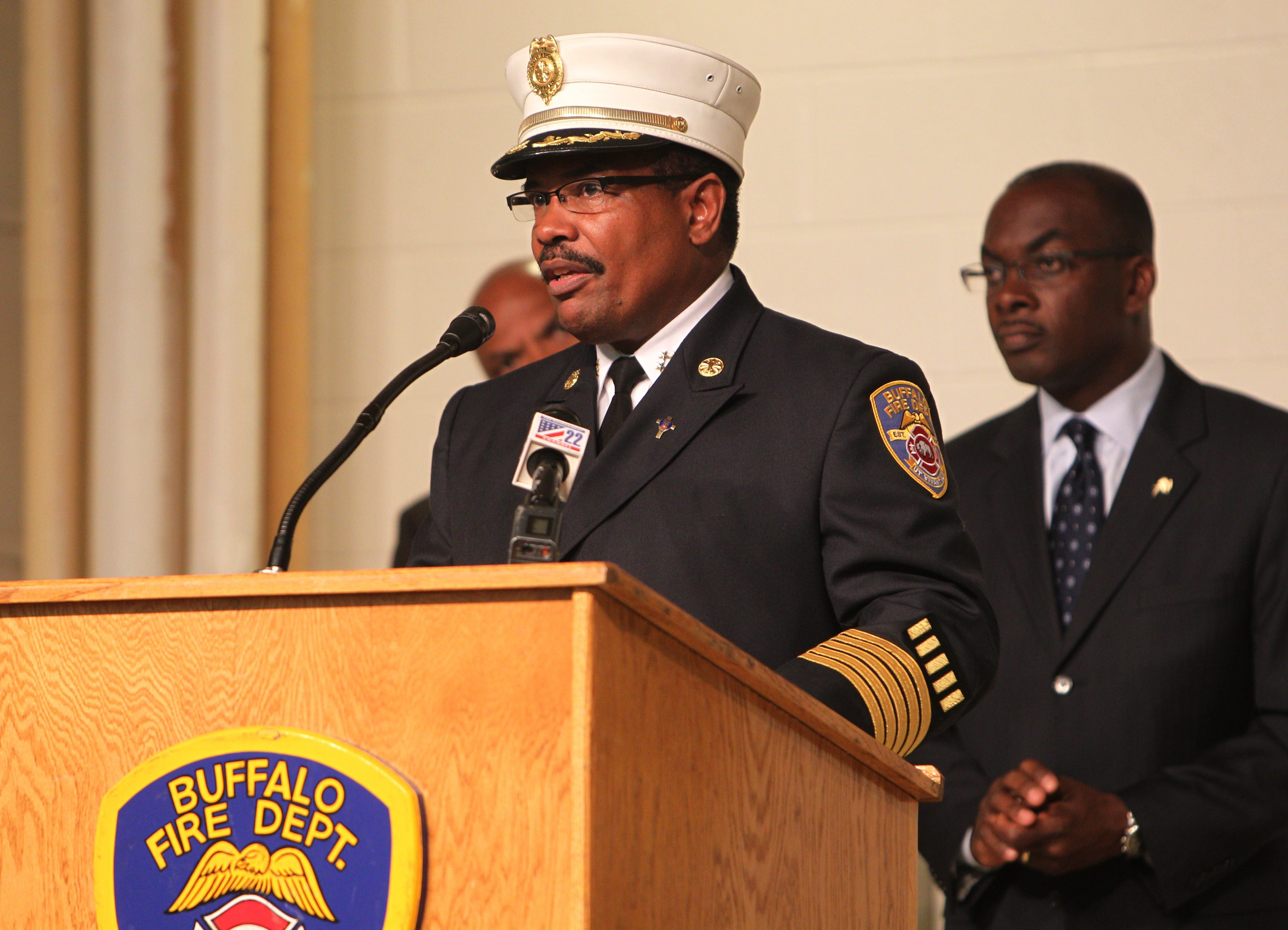 The Buffalo Fire Department held its promotions ceremony, Monday, Sept. 16, 2013.  43 firefighters were promoted to positions of division chief, battalion chief, captain and lieutenant. Fire Commissioner Garnell Whitfield, Jr. makes his remarks after Mayor Byron Brown, behind on right.  (Sharon Cantillon/Buffalo News)