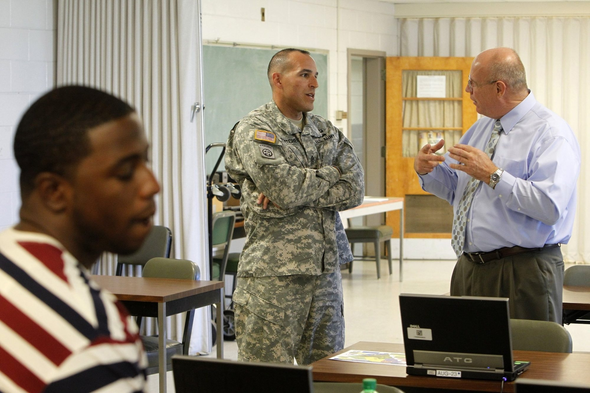 Army Sgt. Maj. Chris Fletcher, center, talks with instructor Duane Norell during a resume-writing course offered as part of the South Carolina National Guard employment services division. Fletcher will enter the civilian job market later this year. With the military downsizing, many soldiers, airmen and Marines will have to do the same.